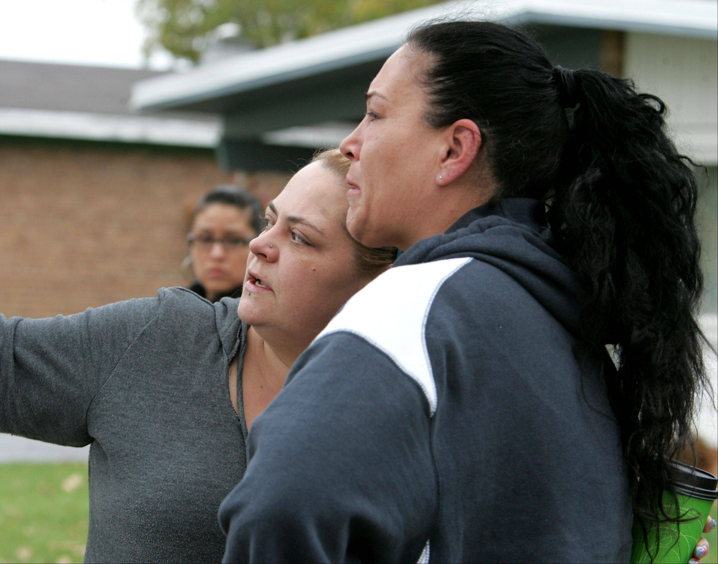Anna Carrillo, left, and Anna Valdez, wait anxiously for news about their children at Indian Trail Junior High as it was on lockdown. Authorities lifted the lockdown after several hours saying there was no danger to students.