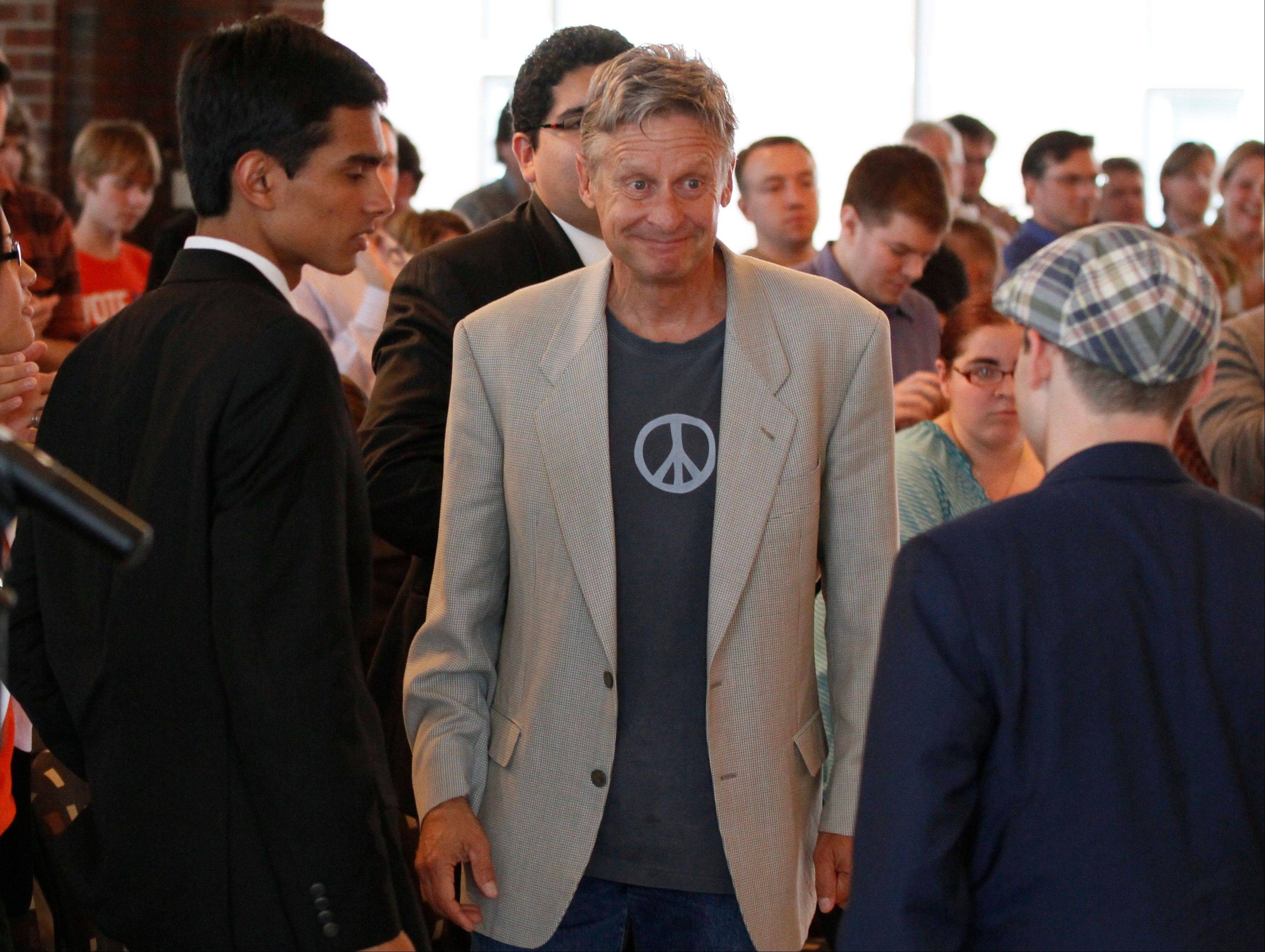 Libertarian Party presidential nominee Gary Johnson, right, greets students at Macalester College in St. Paul, Minn.