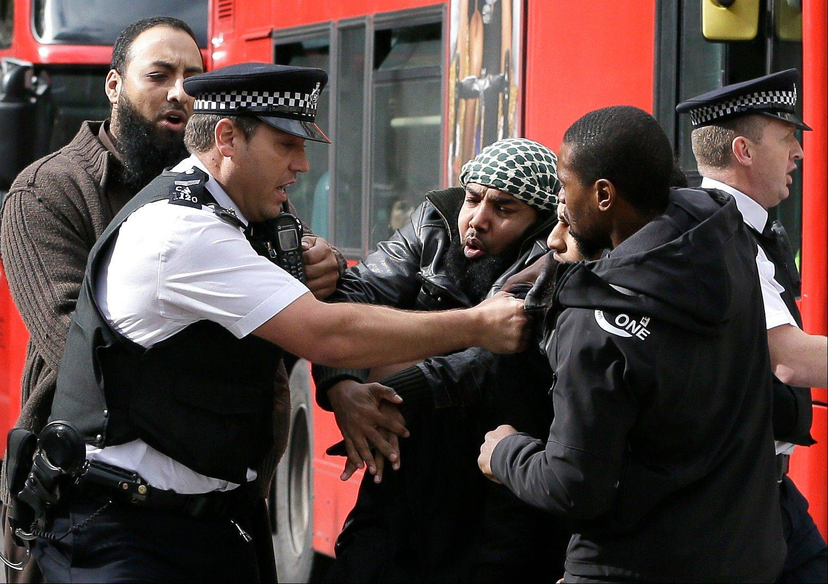 Demonstrators clash with police officers outside The Royal Courts of Justice in London Friday, Oct. 5, 2012. A British court ruled Friday that al-Masri and four other terror suspects can be extradited immediately to the U.S. to face charges there.