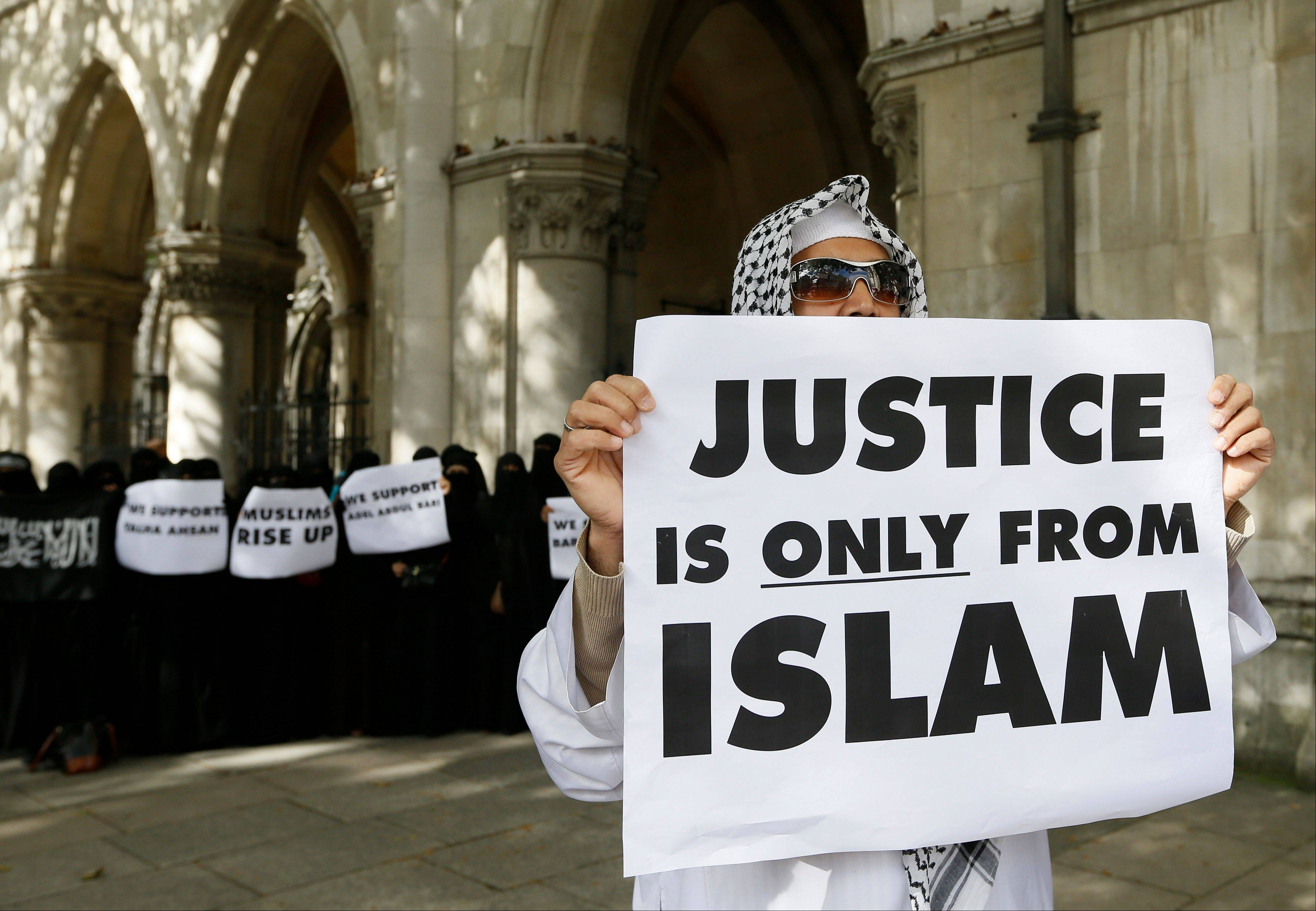 Demonstrators gather outside The Royal Courts of Justice in London Friday, Oct. 5, 2012. A British court ruled Friday that al-Masri and four other terror suspects can be extradited immediately to the U.S. to face charges there.
