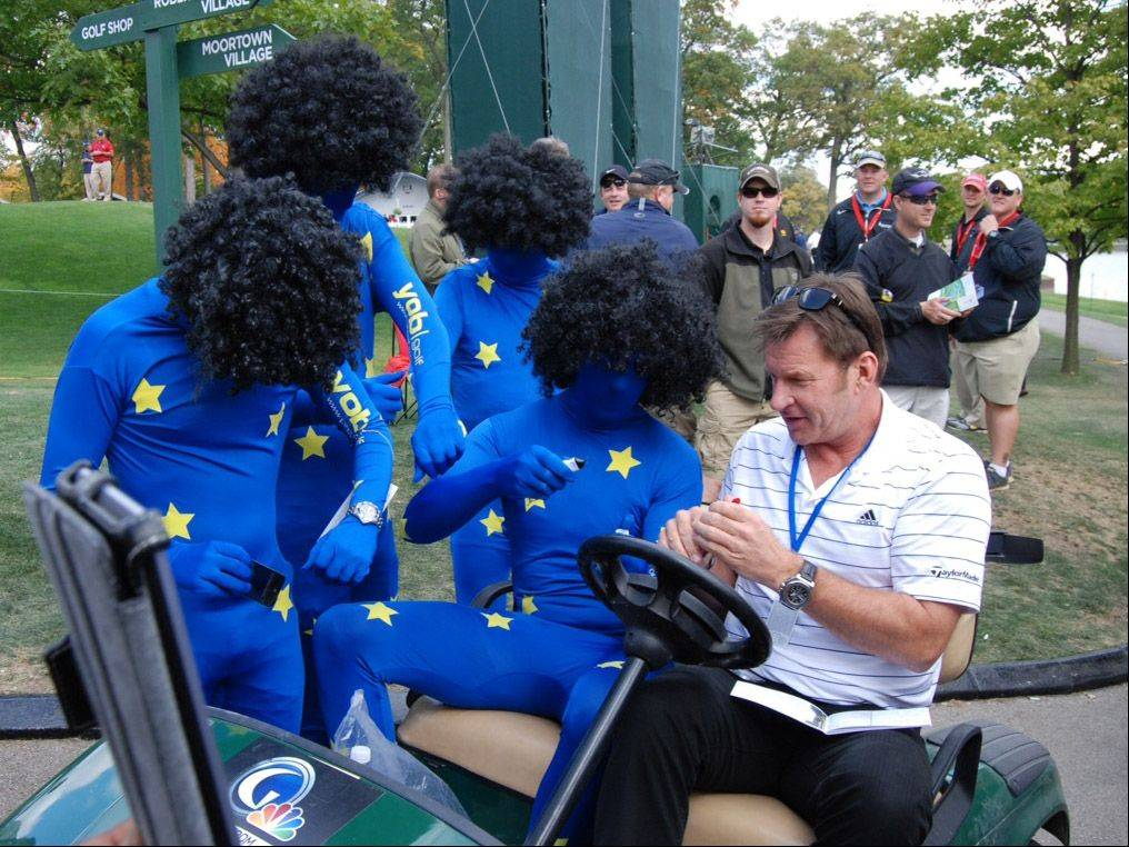 Photo of Nick Faldo, an announcer from the Golf Channel, with some Europeans taken during Thursday's practice round at the Ryder Cup.