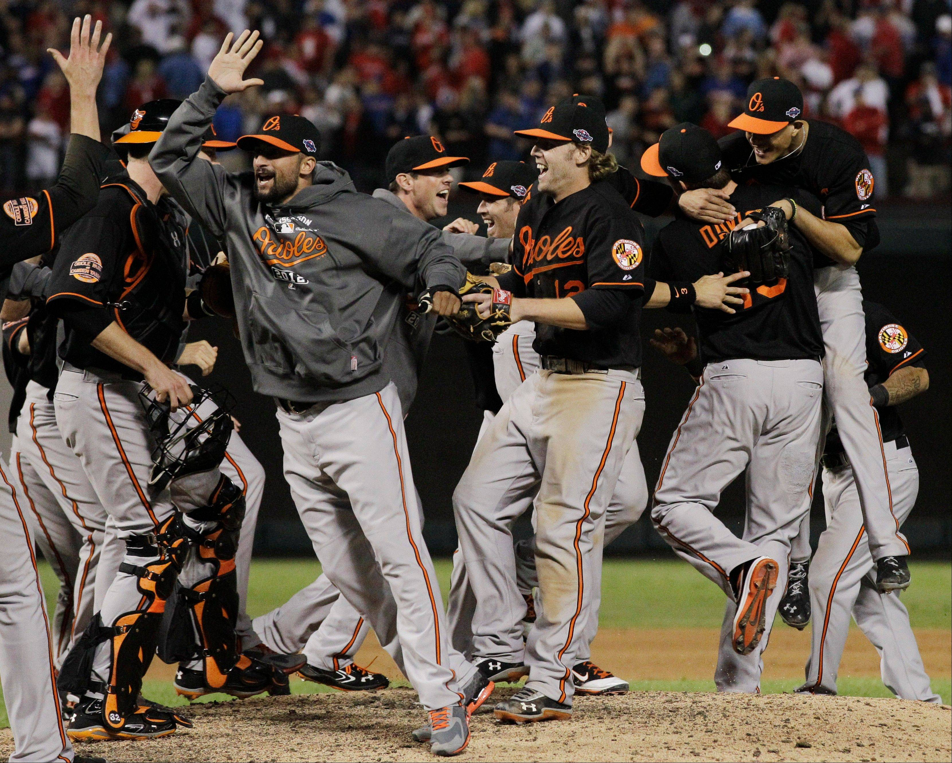 The Baltimore Orioles celebrate winning the American League wild-card playoff game Friday night against the Texas Rangers in Arlington, Texas.