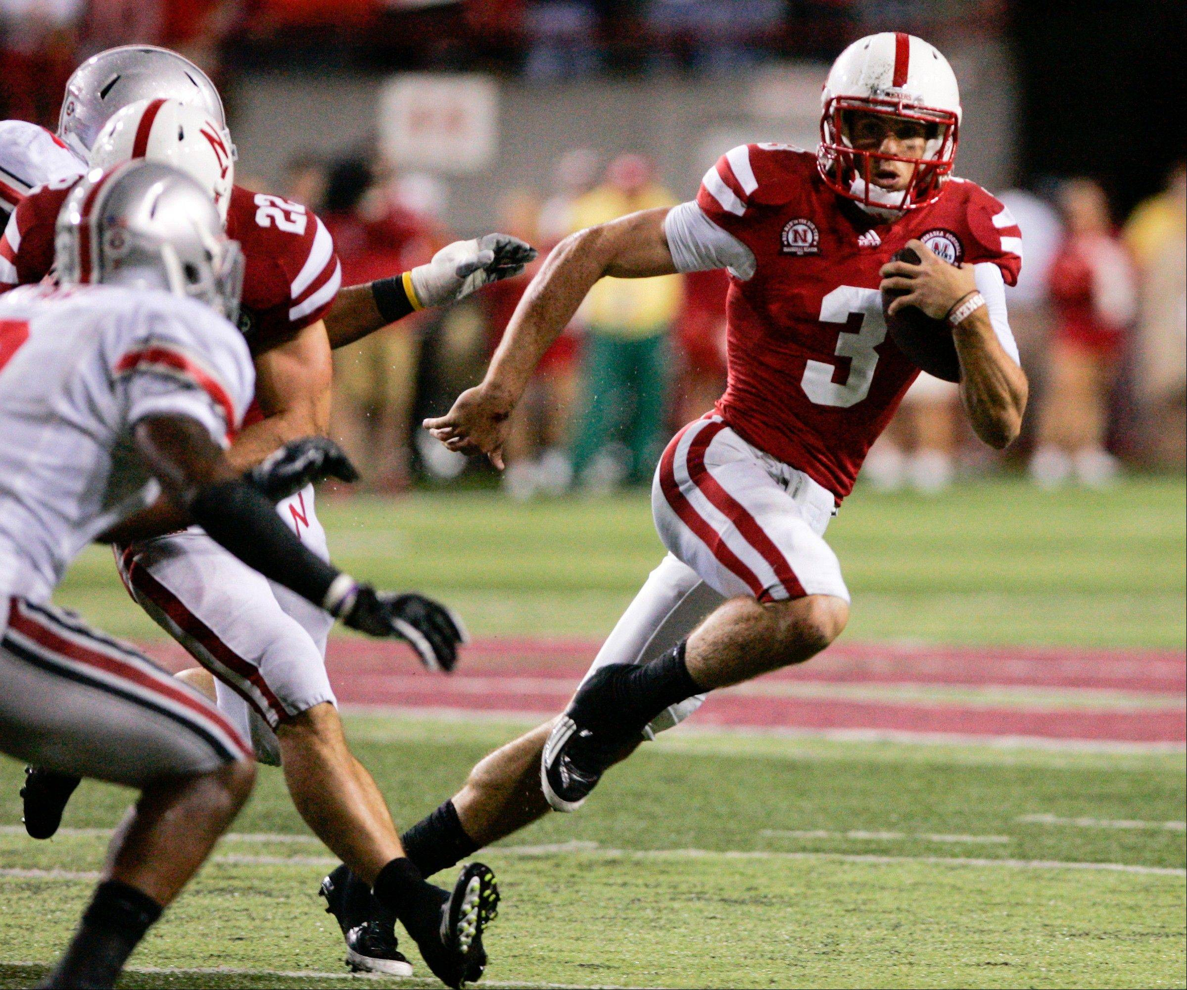 Nebraska quarterback Taylor Martinez carries the ball against Ohio State last October in Lincoln, Neb.
