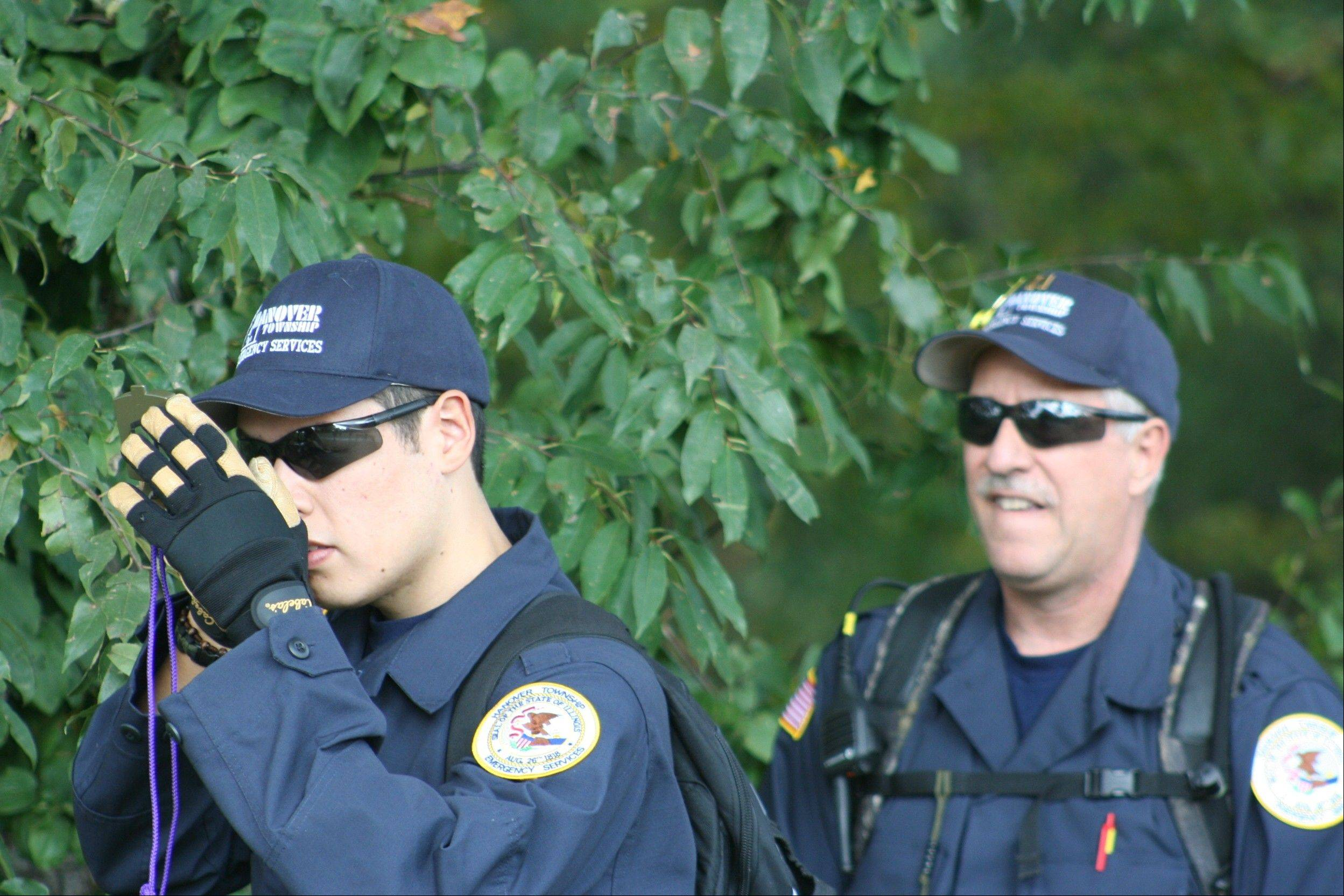 Hanover Township Emergency Services volunteers Eddie Fausto, left, and Bill Potas on the full search exercise for their validation at Mather Woods in Plainfield.