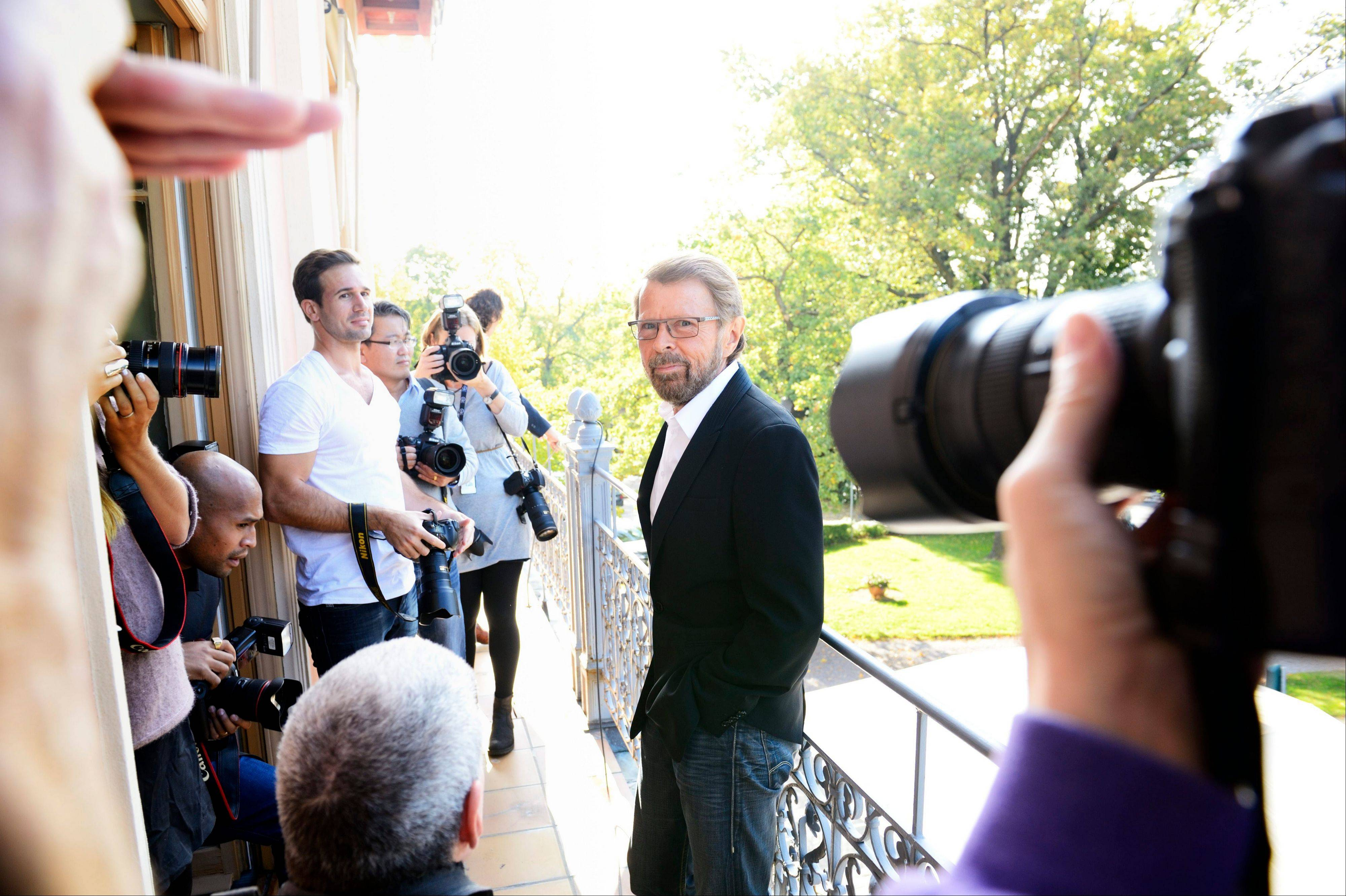 Former ABBA band member Bjoern Ulvaeus, centre, arrives for a news conference, at the ABBA museum construction site in Stockholm., Sweden, Wednesday Oct. 3, 2012. A traveling ABBA exhibit is to get a permanent home in a new museum dedicated mostly to the Swedish quartet that has sold nearly 400 million records since its heyday in the 1970s. Former band member Bjoern Ulvaeus said Wednesday that �ABBA The Museum� will be part of a Swedish music hall of fame to be inaugurated in Stockholm next spring.