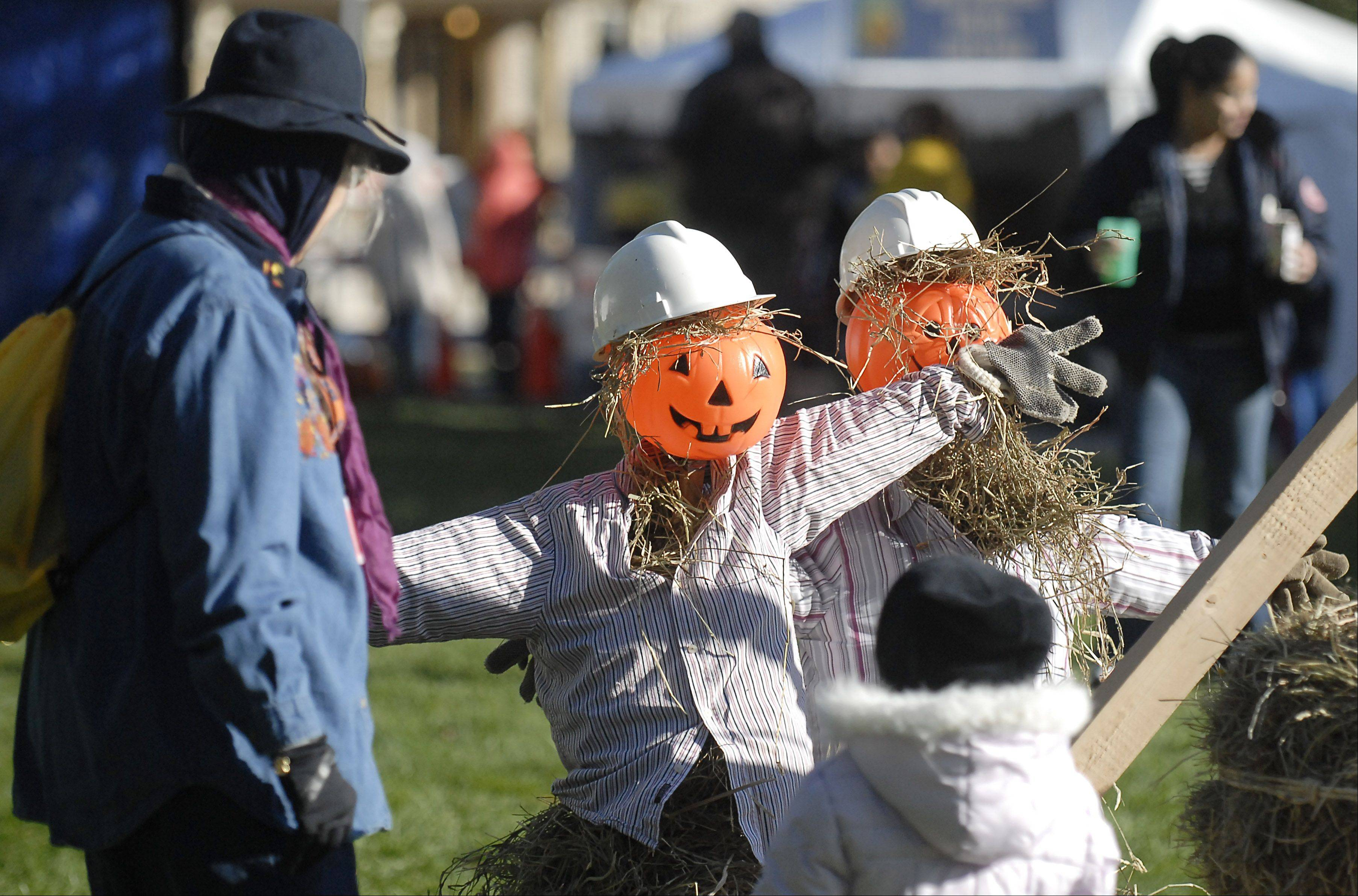 Visitors attend the St. Charles Scarecrow Fest on Saturday.