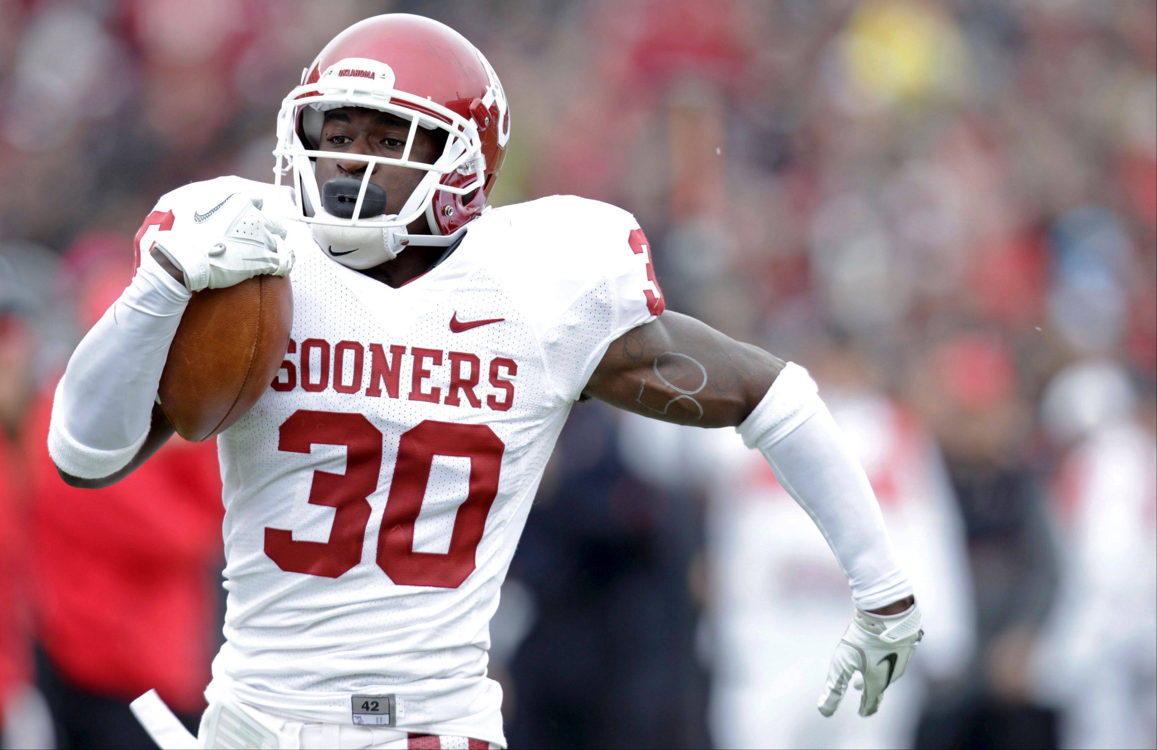 Oklahoma�s Javon Harris returns an interception for a touchdown against Texas Tech on Saturday in Lubbock, Texas.