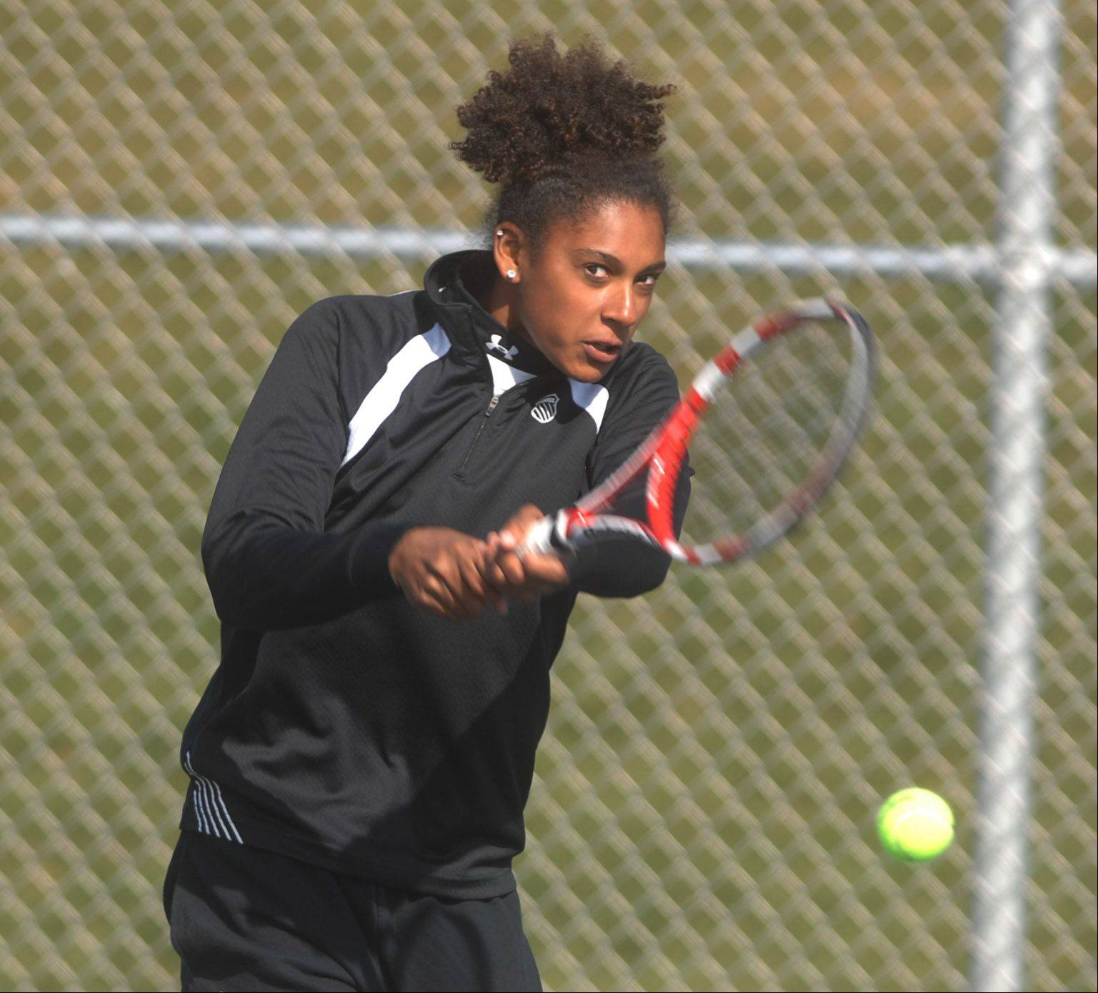 Keisha Clousing of Wheaton Warrenville South plays Tiffany Chen of Naperville (she is not pictured) during the DuPage Valley Conference girls tennis at Naperville North Saturday.