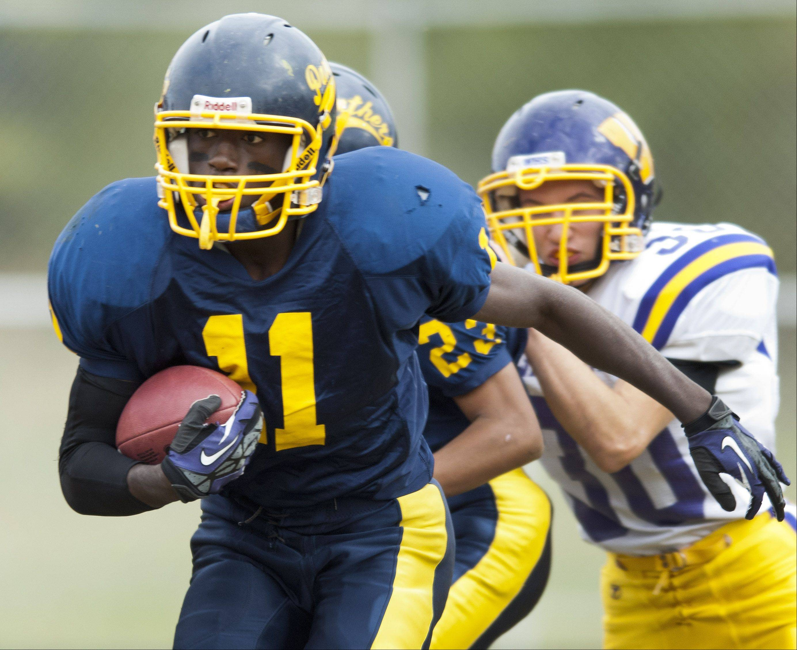 Round Lake�s Chris Washington carries the ball during Saturday�s game against Wauconda.