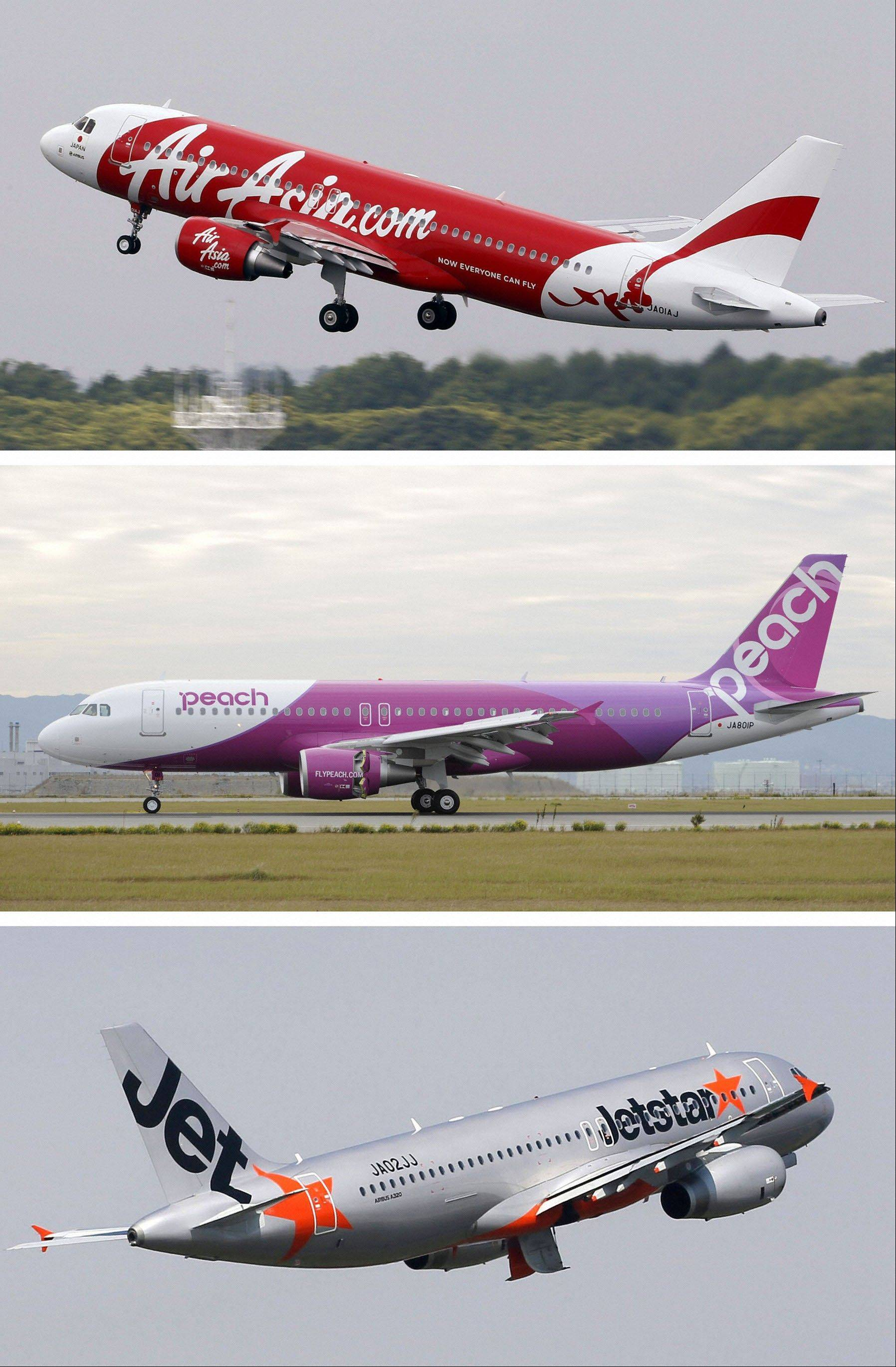 In this combination of three undated photos, planes of Japan's low-cost airlines, from top, AirAsia Japan, Peach Aviation and Jetstar, are shown in Japan.