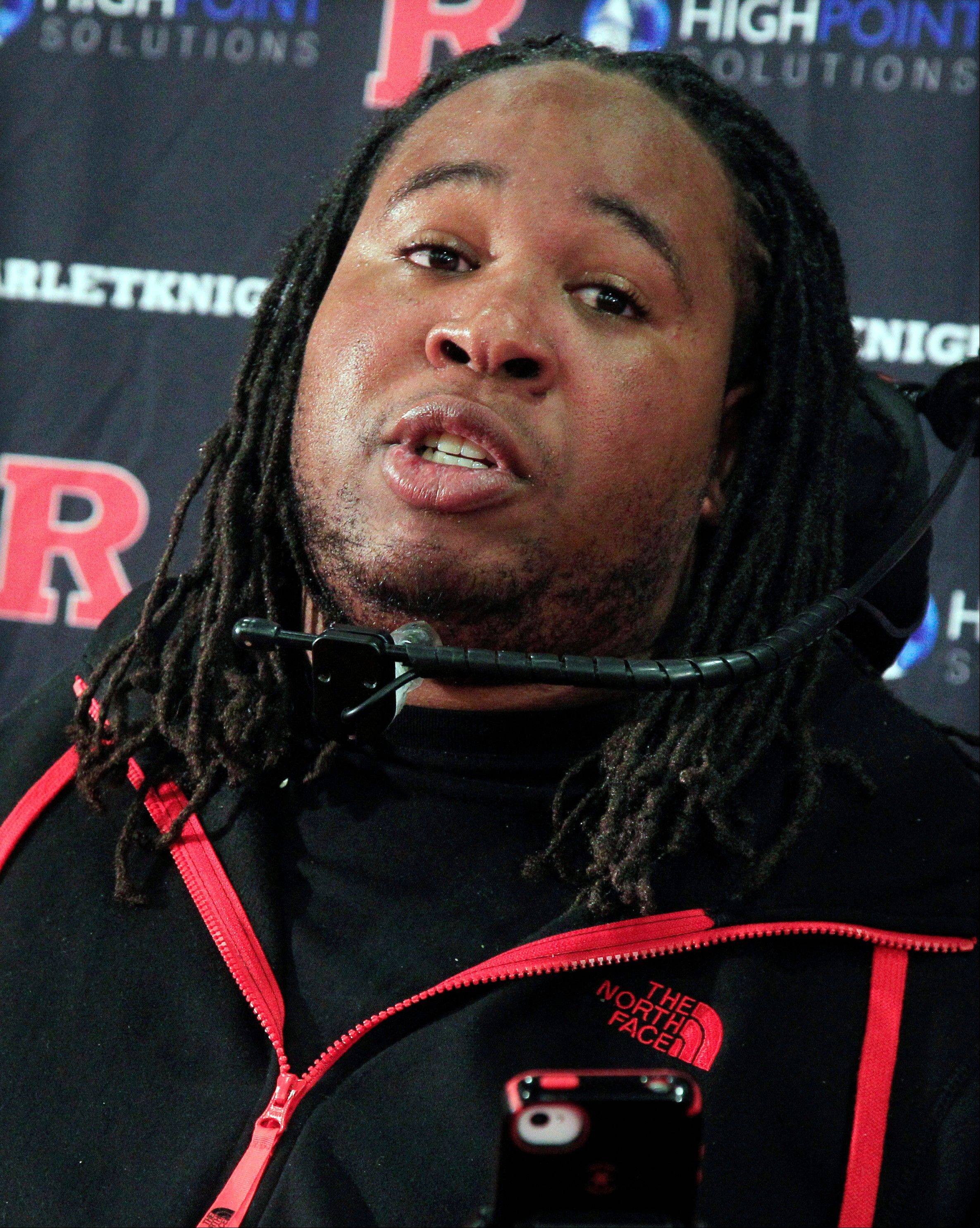 This May 2, 2012 file photo shows paralyzed former Rutgers defensive tackle Eric LeGrand answering a question during a news conference in Piscataway, N.J. Hurdler Lolo Jones trash-talked about head injuries to former Rutgers football player Eric LeGrand, Tuesday, Oct. 2, 2012, after he jokingly challenged her to a race on Twitter. Jones didn't know the defensive tackle was paralyzed in a game.
