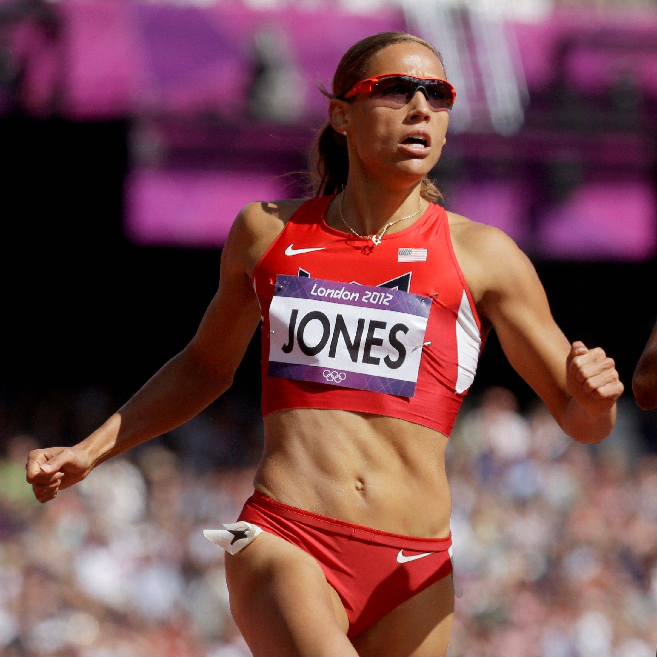 This Aug. 6, 2012 file photo shows hurdler Lolo Jones competing in a women's 100-meter hurdles heat at at the 2012 Summer Olympics in London. Jones trash-talked about head injuries to former Rutgers football player Eric LeGrand, Tuesday, Oct. 2, 2012, after he jokingly challenged her to a race on Twitter. Jones didn't know the defensive tackle was paralyzed in a game.