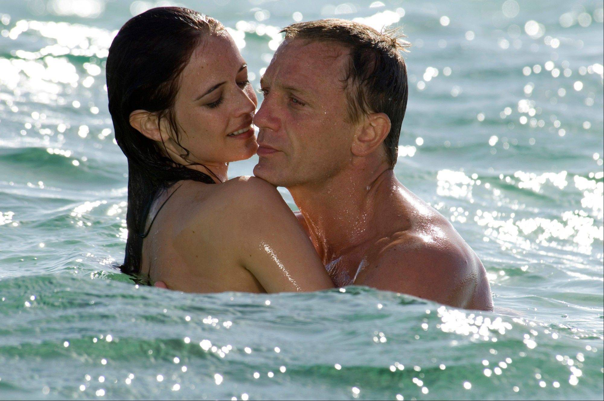 "Daniel Craig, right, appears with Eva Green in the 2006 James Bond film, ""Casino Royale."" Whatever their role, Bond girls still must be inarguably beautiful."