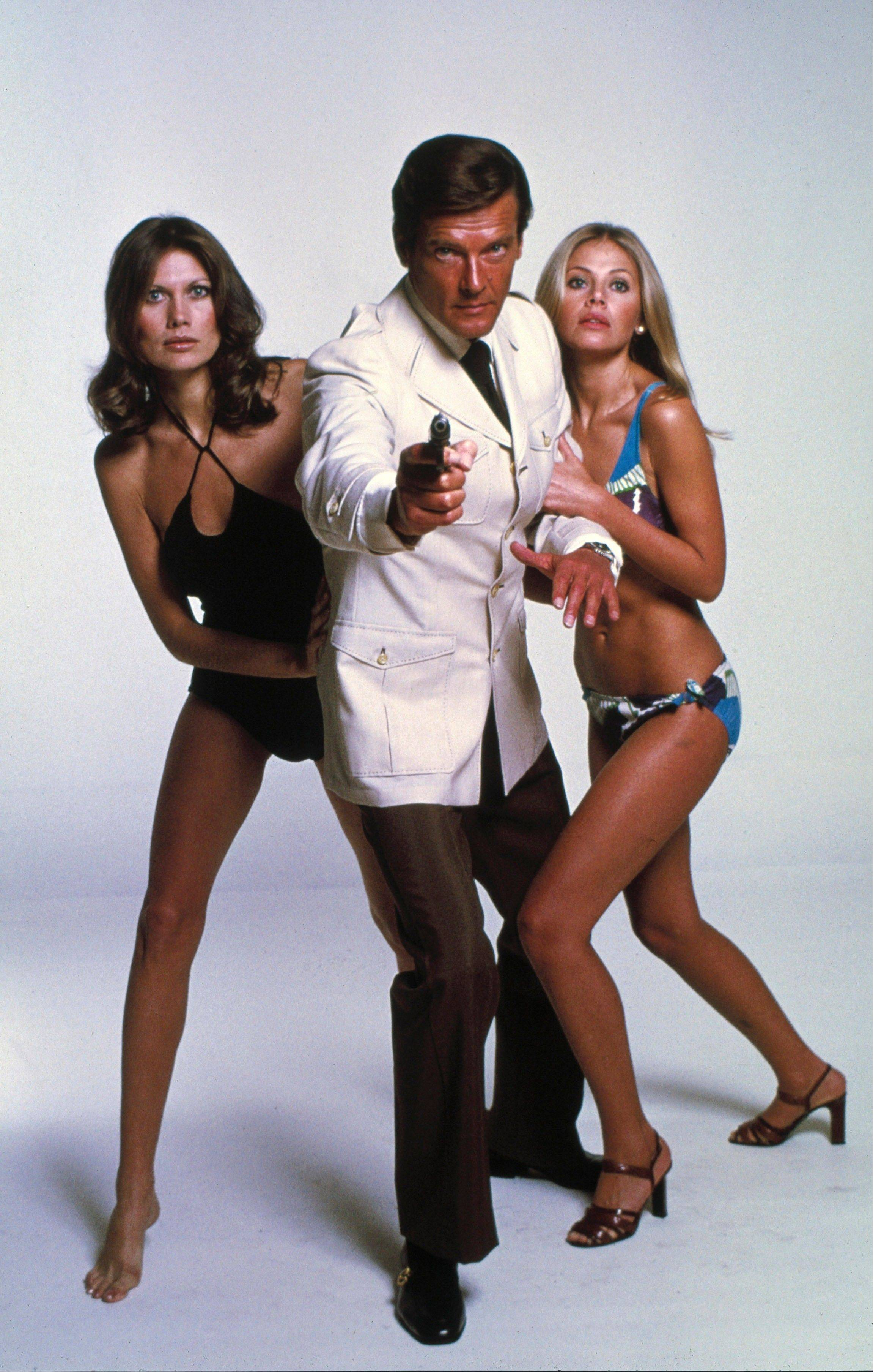 "Roger Moore, center, with Maud Adams, left, and Britt Ekland, from the James Bond 1974 film, ""The Man with the Golden Gun."" Whatever their role, Bond girls still must be inarguably beautiful. The film is included in the MGM and 20th Century Fox Home Entertainment Blu-Ray ""Bond 50"" anniversary set."