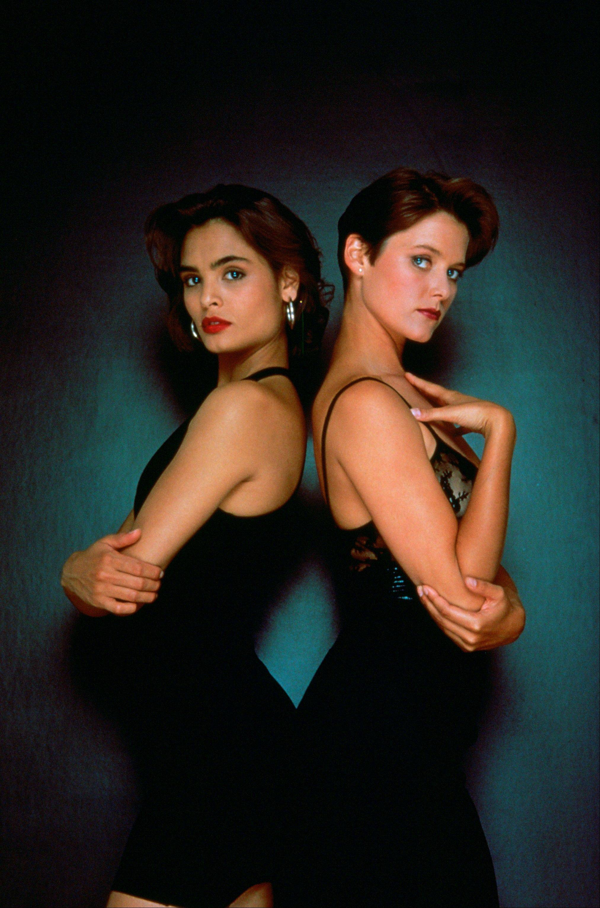 "Talisa Soto, left, and Carey Lowell in the James Bond 1989 film, ""Licence to Kill."" Always glamorous and sophisticated, yet uniquely susceptible to James Bond's flirtations, the Bond girl over the years has become as compelling as Agent 007 himself."