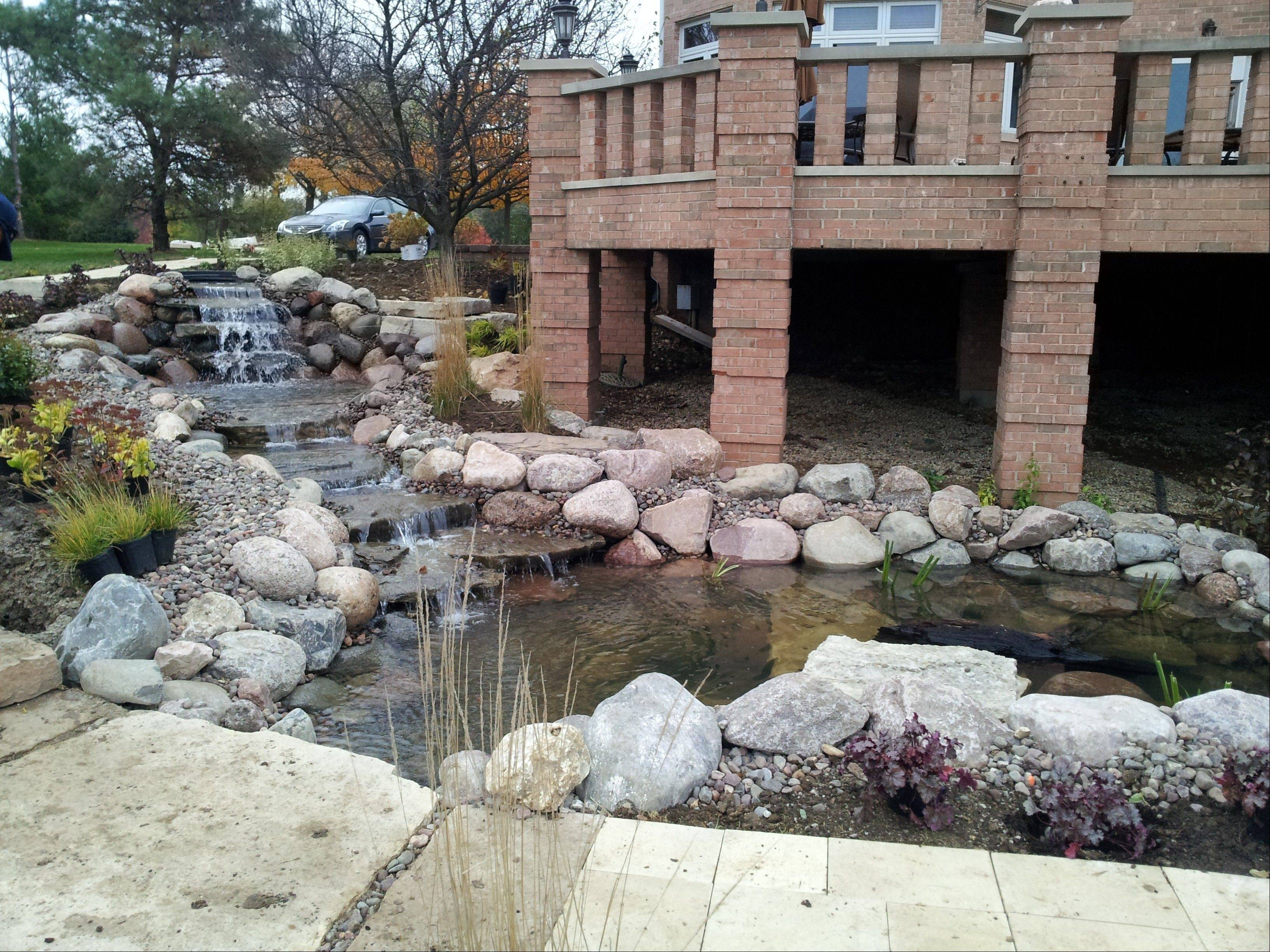 In addition to fountains, natural stone is being used for patios and walkways, says Colin Taheny of RYCO Landscaping.