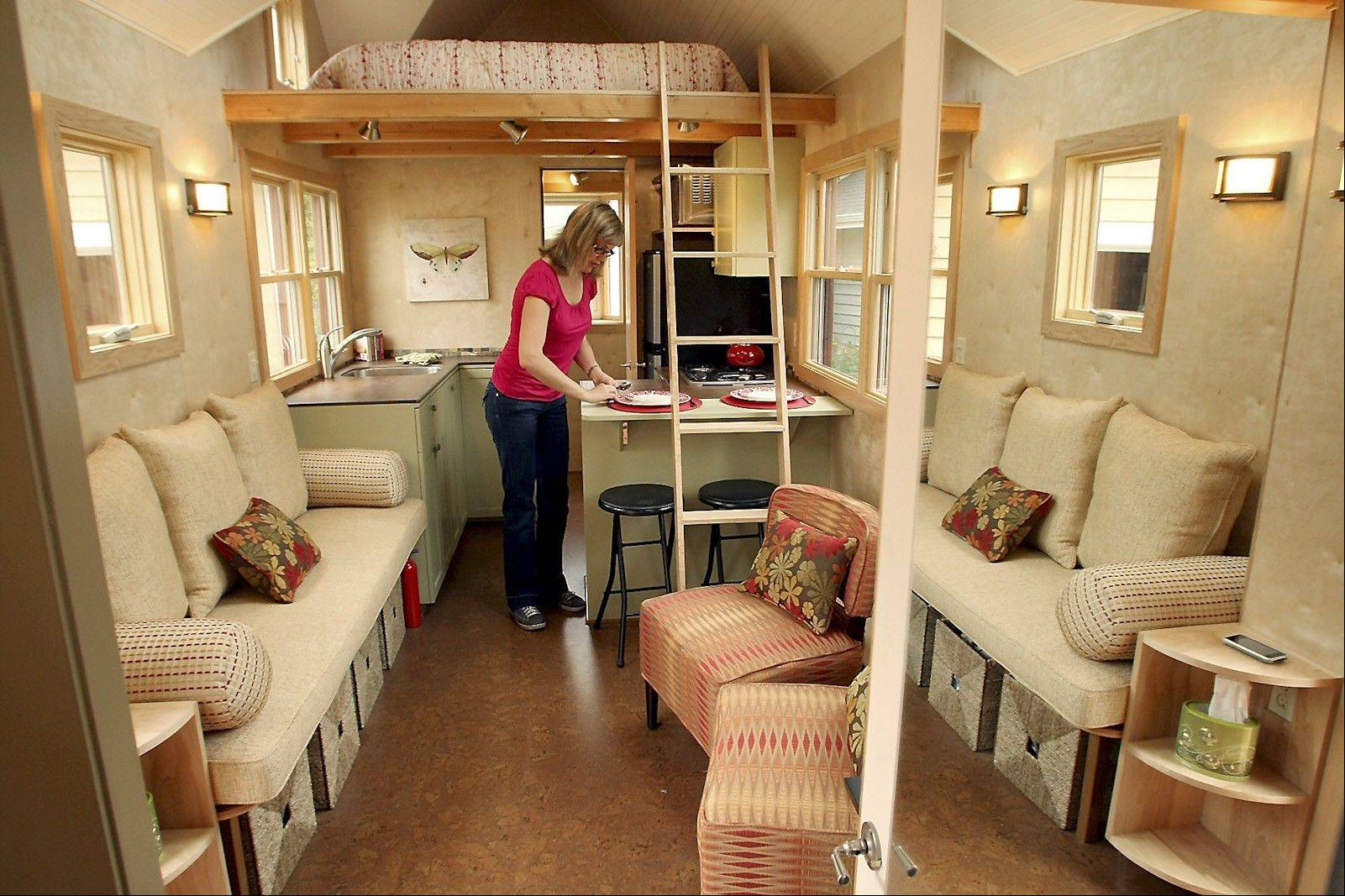Superb Sharon Read, Founder Of Seattle Tiny Homes, Places Dishes In The Dining  Area In