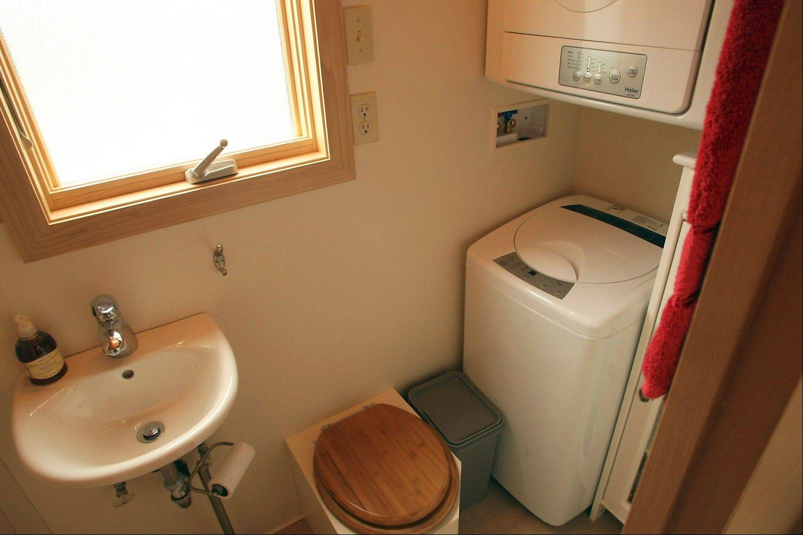 The bathroom features a small clothes washer and dryer.