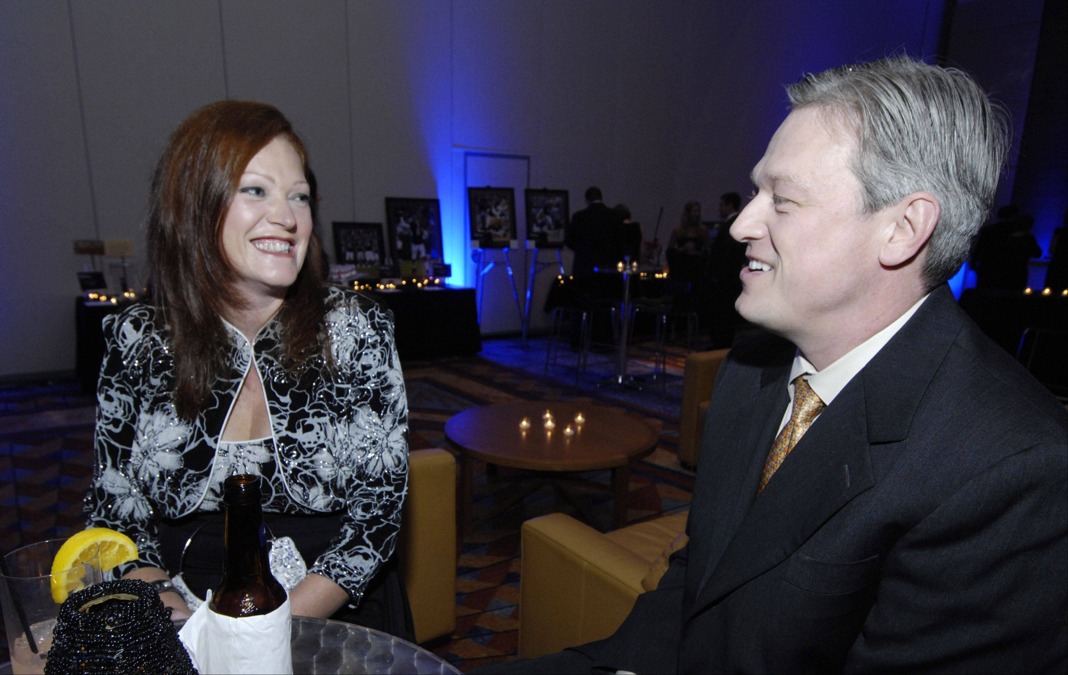Laura Suffi of Schaumburg and her husband, Reno, chat during the Schaumburg Business Association gala and awards Saturday at the Renaissance Convention Center Hotel.
