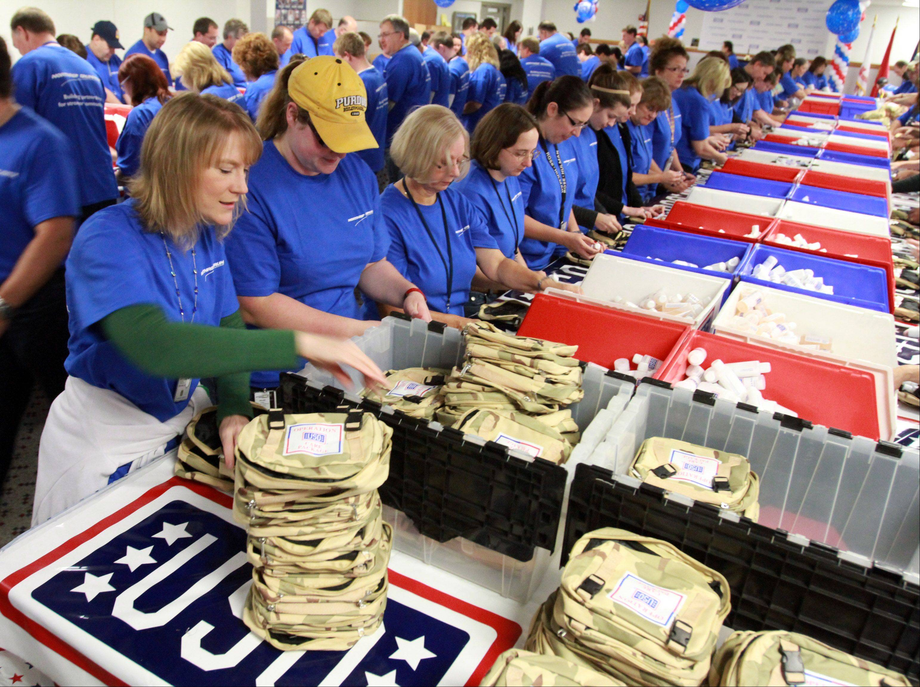 About 150 employees at Northrop Grumman Corp. stuff USO care packages at the company's Rolling Meadows operation on Saturday.