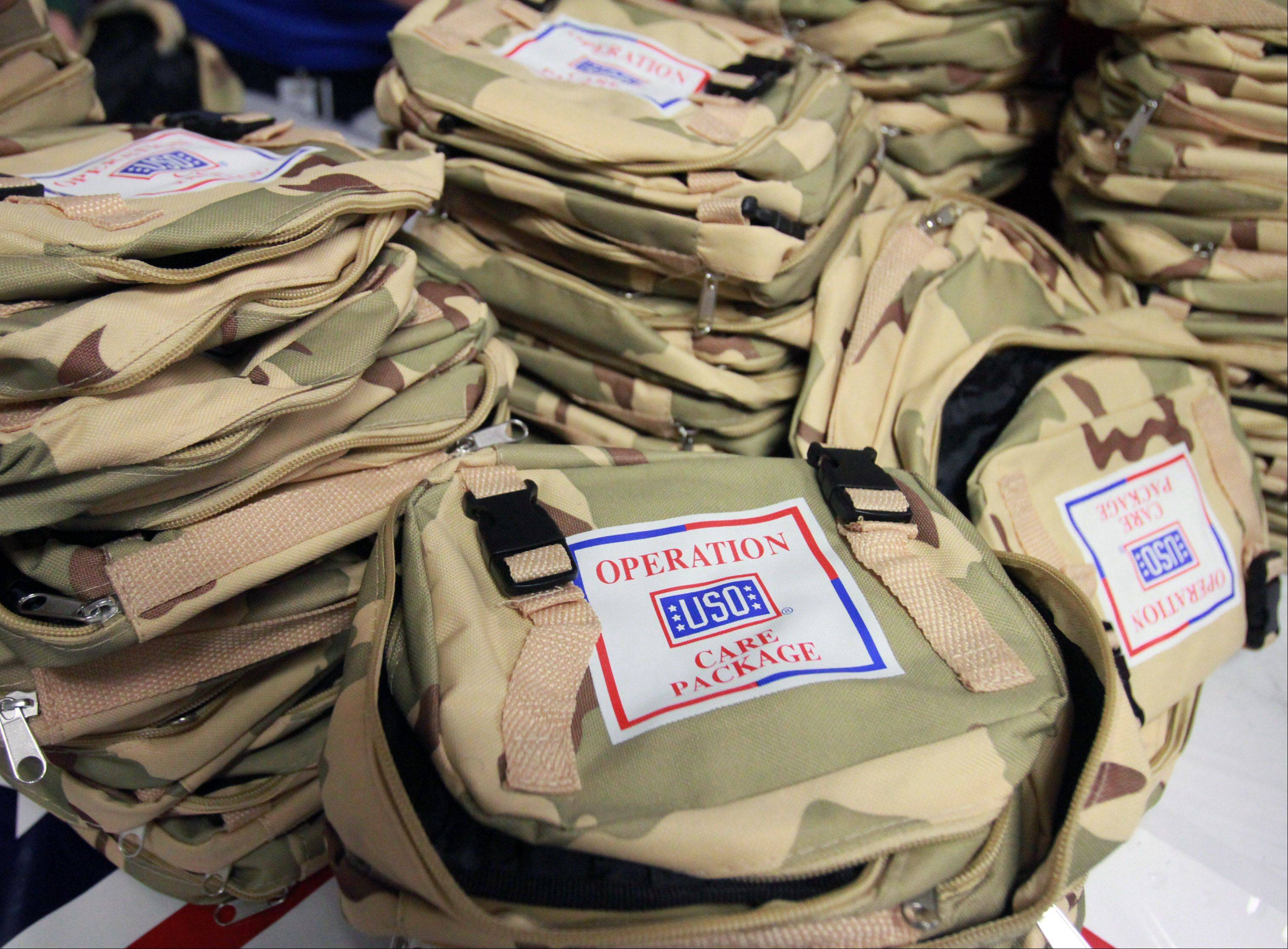 Employees at Northrop Grumman stuffed USO care packages Saturday at the company offices in Rolling Meadows.