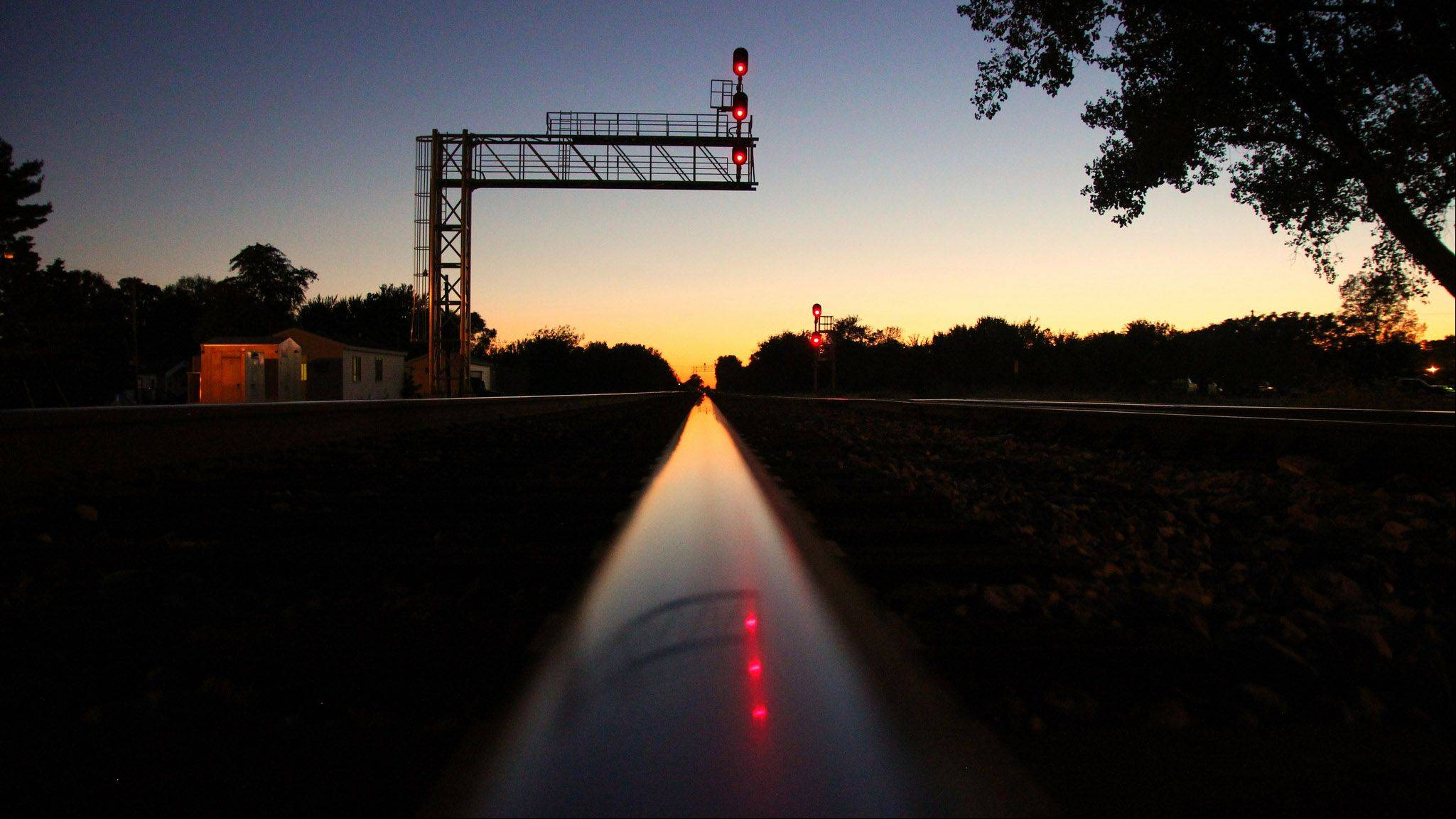 "Larry Pearlman of Naperville won our September Photo Finish contest with this image that he calls ""Polished Rails -- Sunset in Tolono, Illinois."""