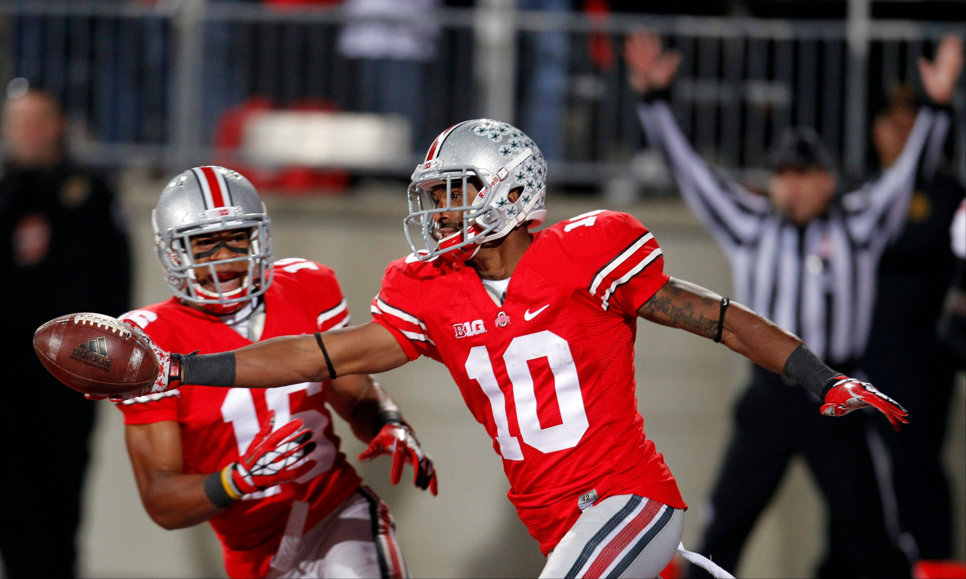 Ohio State wide receiver Corey Brown (10) celebrates after returning a punt 76 yards for a touchdown against Nebraska Saturday in Columbus, Ohio.