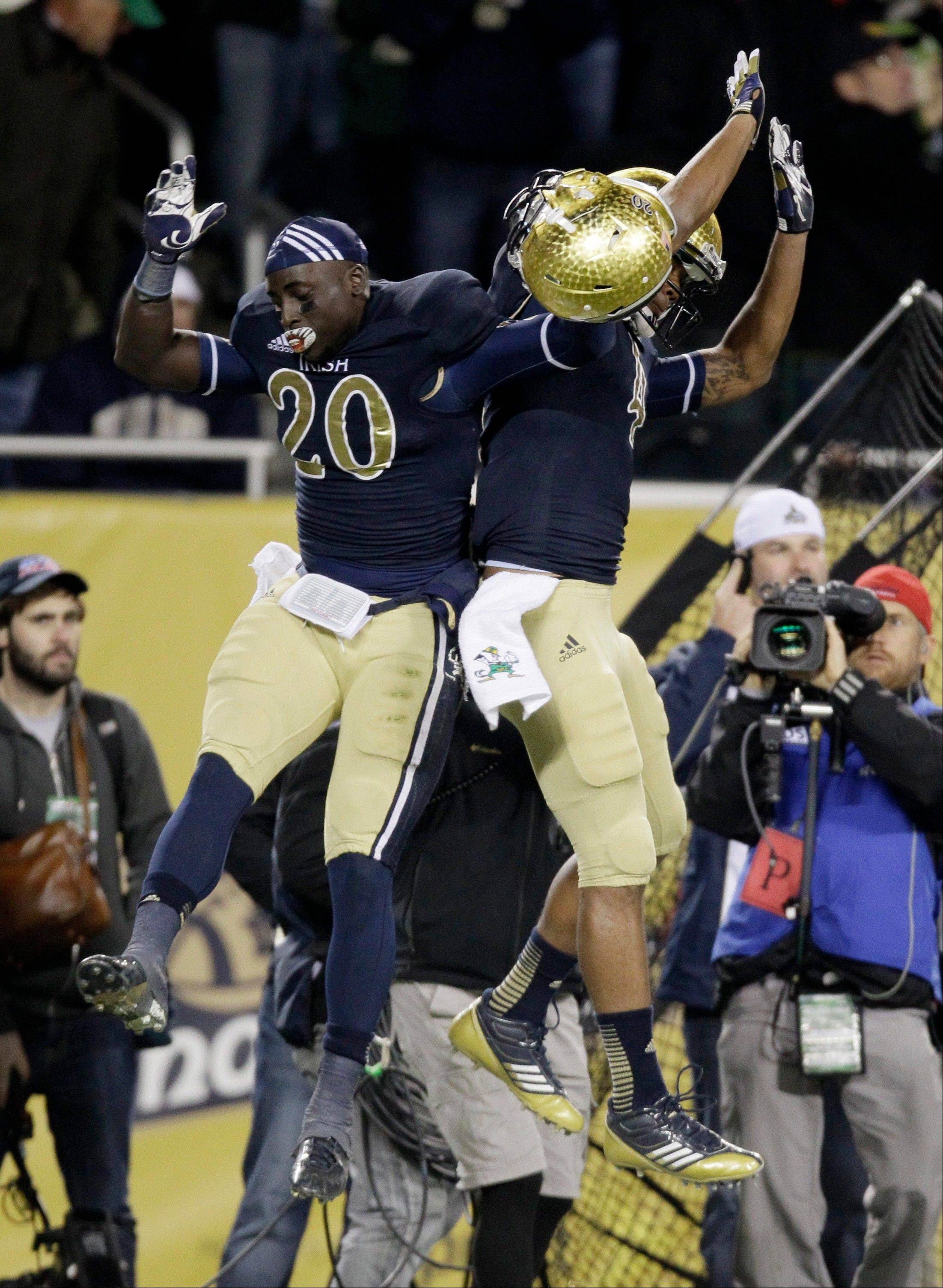 Notre Dame running back Cierre Wood and running back George Atkinson III, celebrate Woods touchdown Saturday during the second half at Soldier Field.