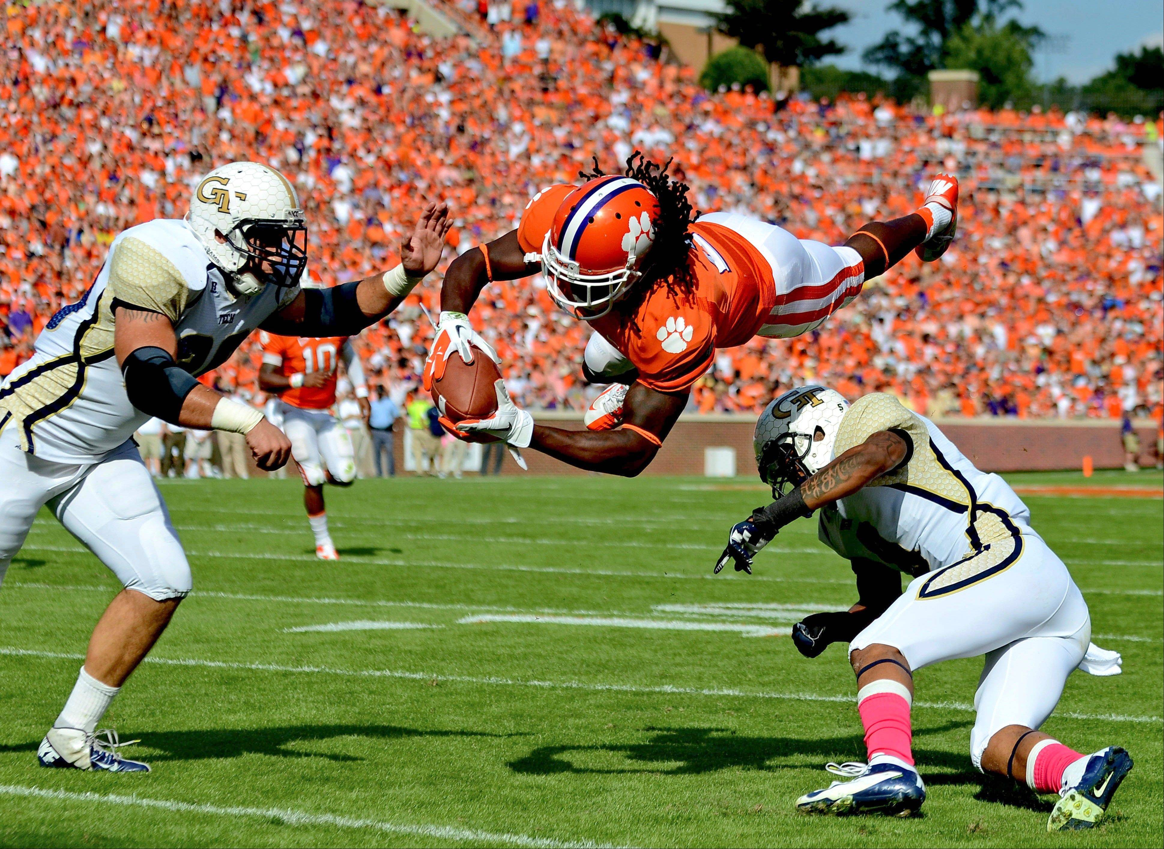 Clemson wide receiver Sammy Watkins dives between Georgia Tech defenders Daniel Drummond, left, and Louis Young to the 1-yard line during the first half Saturday at Memorial Stadium in Clemson, S.C.