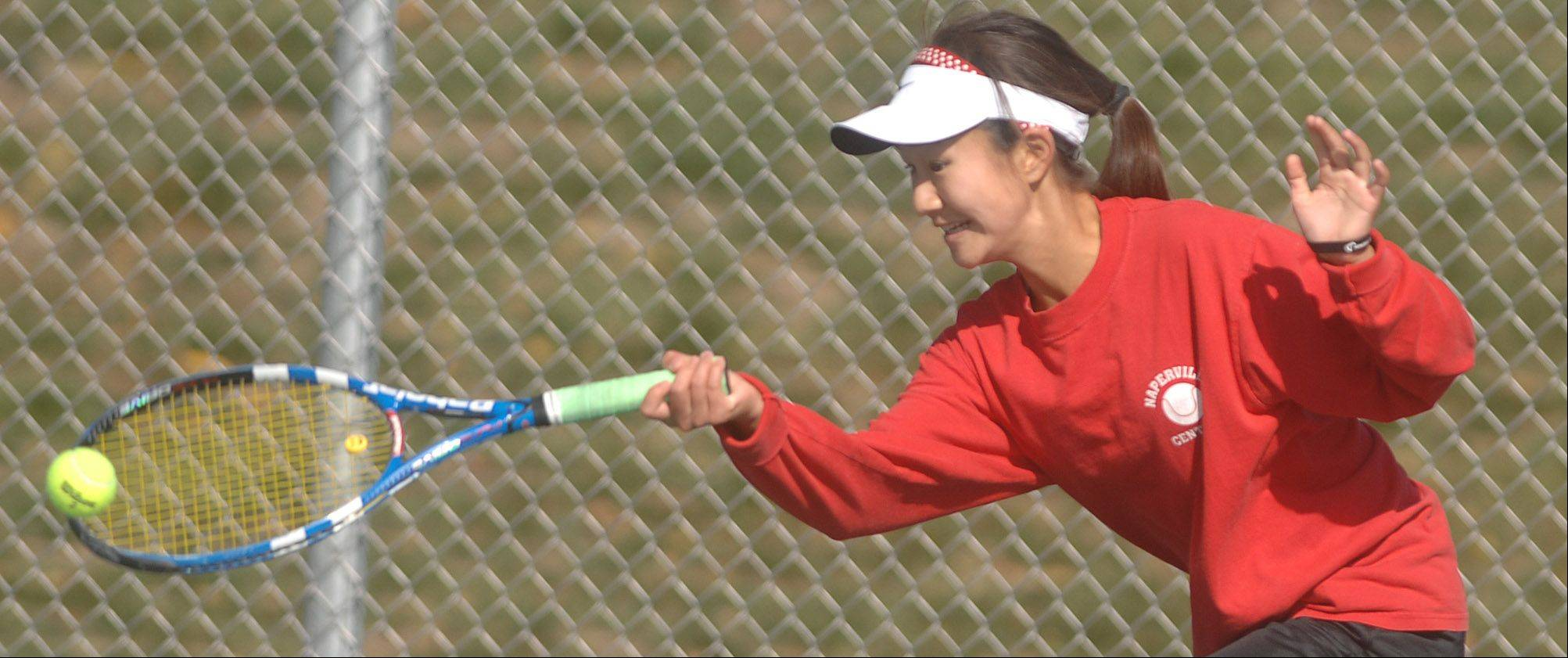 Keisha Clousing of Wheaton Warrenville South (she is not pictured) plays Tiffany Chen of Naperville during the DuPage Valley Conference girls tennis at Naperville North Saturday.