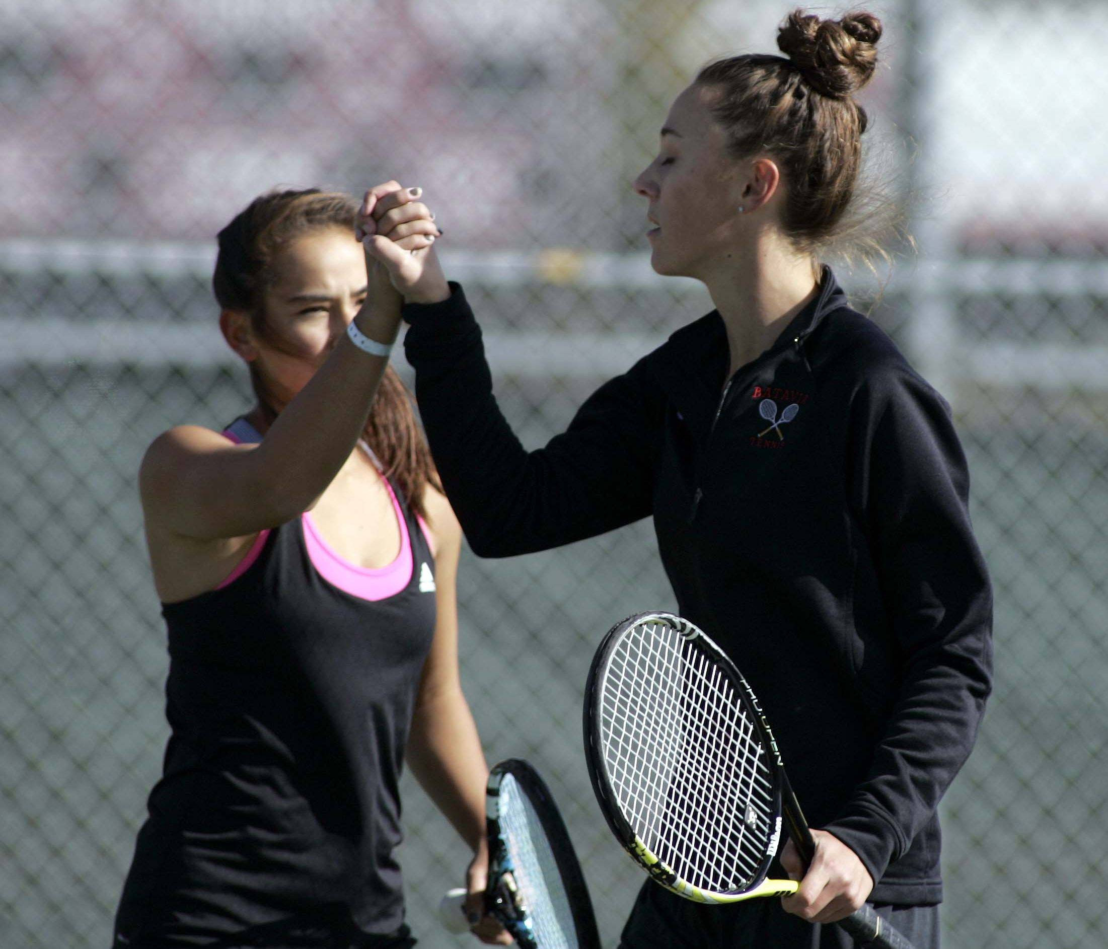 Batavia's Jenny Mizikar, right, and Amelia Cogan, left, celebrate a point at the Upstate Eight Rive tennis meet Saturday at Elgin.