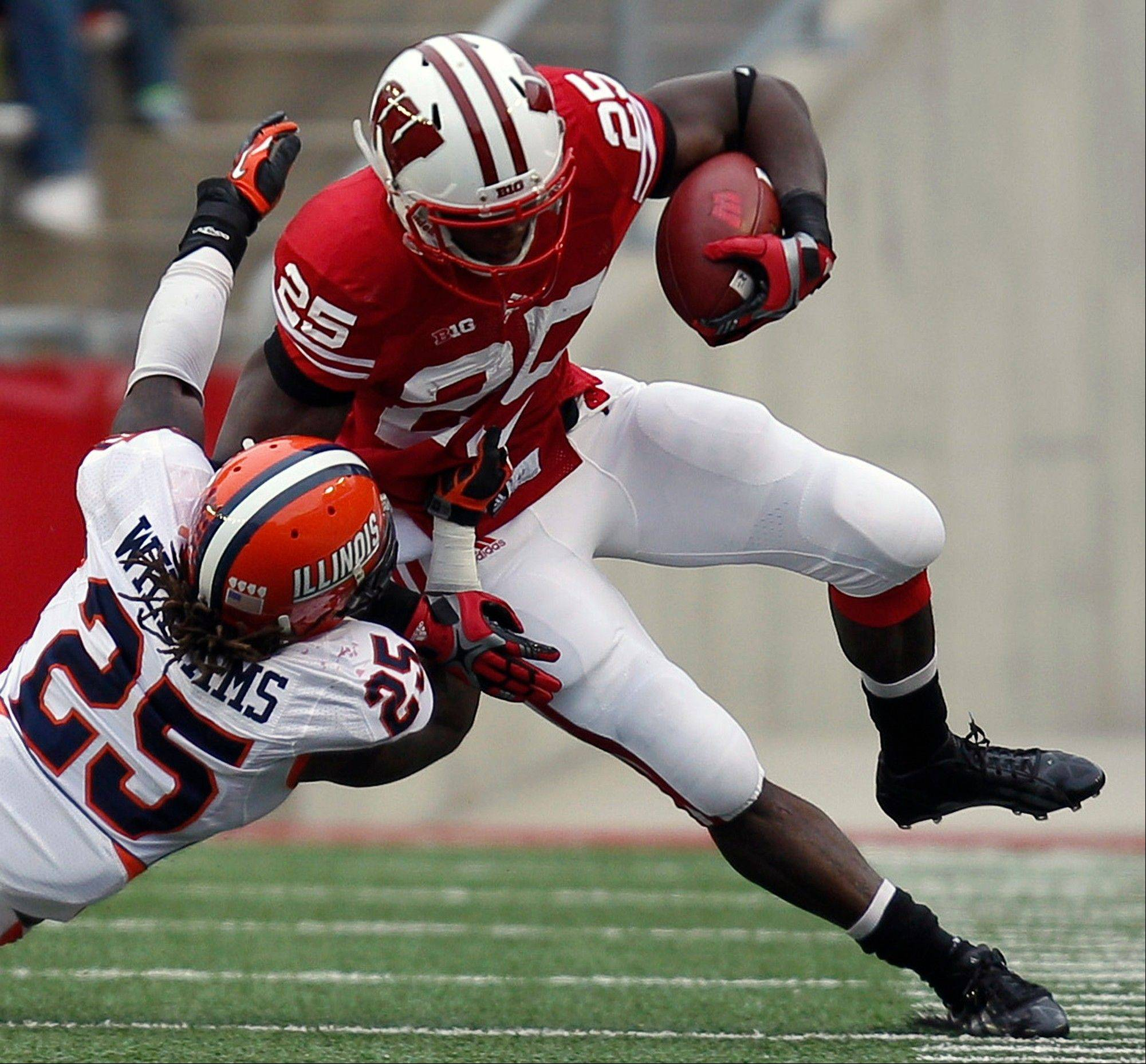 Wisconsin running back Melvin Gordon runs against Illinois linebacker Ashante Williams Saturday during the first half in Madison, Wis.