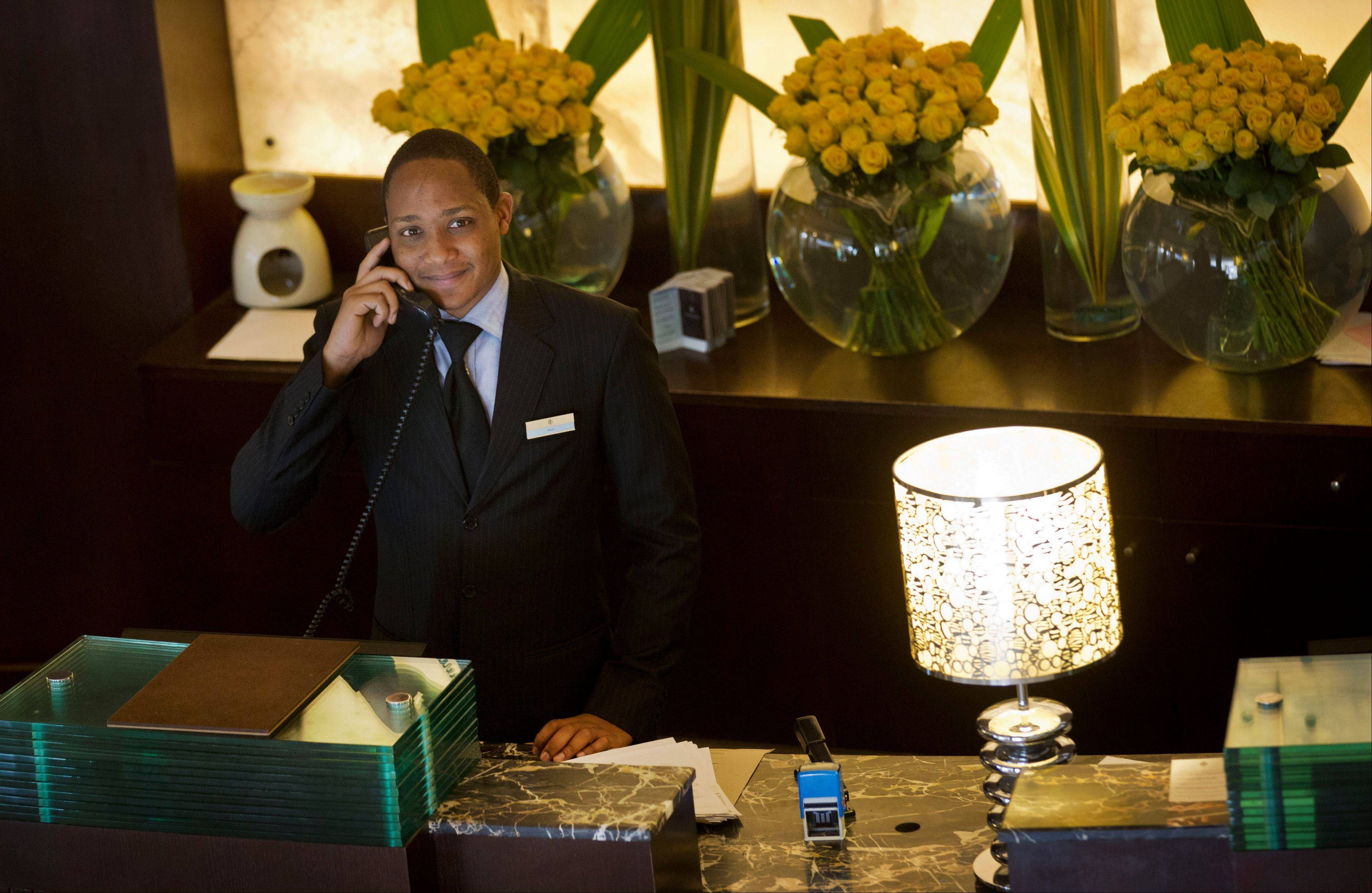 A receptionist takes a call at the front desk of the Sankara Nairobi hotel in Nairobi, Kenya. International hotel developers are planning nearly 40,000 new rooms across Africa in the coming years, the continent's business travel is increasing, and Africa's middle class will soon begin leisure travel en masse.