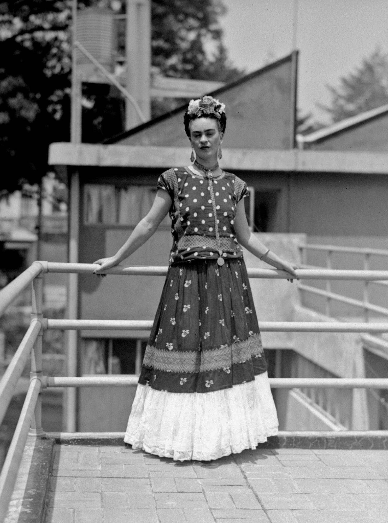 In this April 14, 1939 file photo, painter and surrealist Frida Kahlo, who was the wife of noted Mexican muralist Diego Rivera, poses at her home in Mexico City. A full collection from Kahlo's wardrobe will go on public display Nov. 22 in Mexico City after being locked for nearly 50 years in her armoires and dressers: jewelry, shoes and clothes that still carry the scent of the late artist's perfume and cigarette smoke or stains from painting.