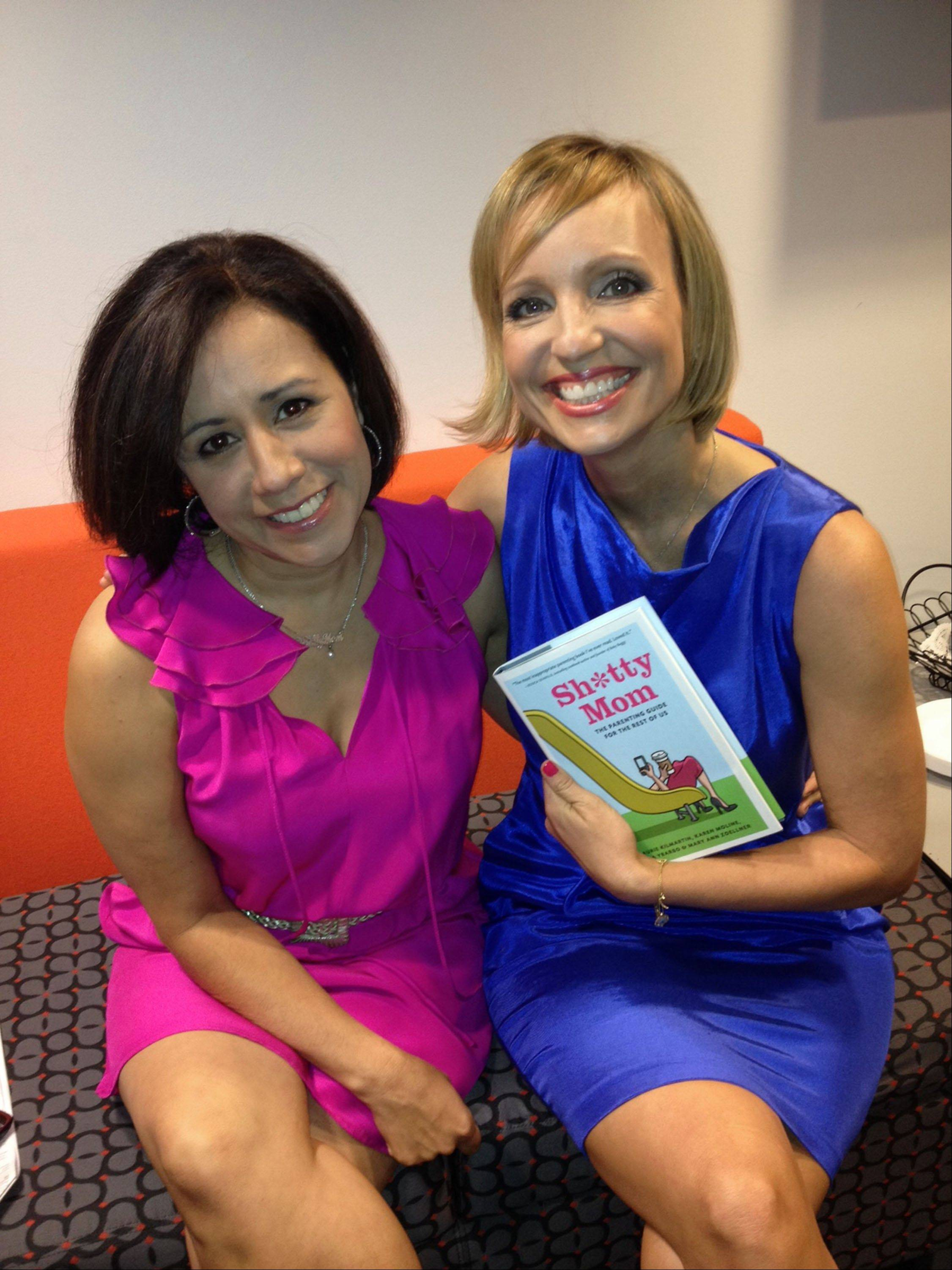 This Sept. 11, 2012 image released by Yfat Reiss Gendell shows Alicia Ybarbo, left, and Mary Ann Zoellner, two of four authors of �Sh*tty Mom,� posing with their book in New York. The latest in irreverent parenting books is part parody and part painful truth. It�s written by four very busy, often tired working moms looking to offer some overdue LOLs as counterpoint to today�s parenting-to-perfection mania.