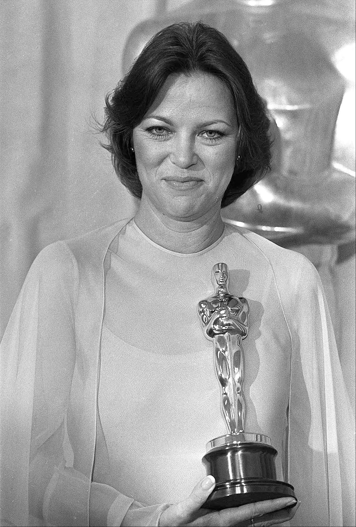 "In this March 29, 1976 file photo, actress Louise Fletcher holds the Oscar for ""Best Actress"" which she won for her performance in ""One Flew Over The Cuckoo's Nest"" at the Academy Awards in Los Angeles. Fletcher says she's no longer able to watch the movie ""One Flew Over the Cuckoo's Nest"" because the character she won an Oscar for, Nurse Ratched, is so cruel."
