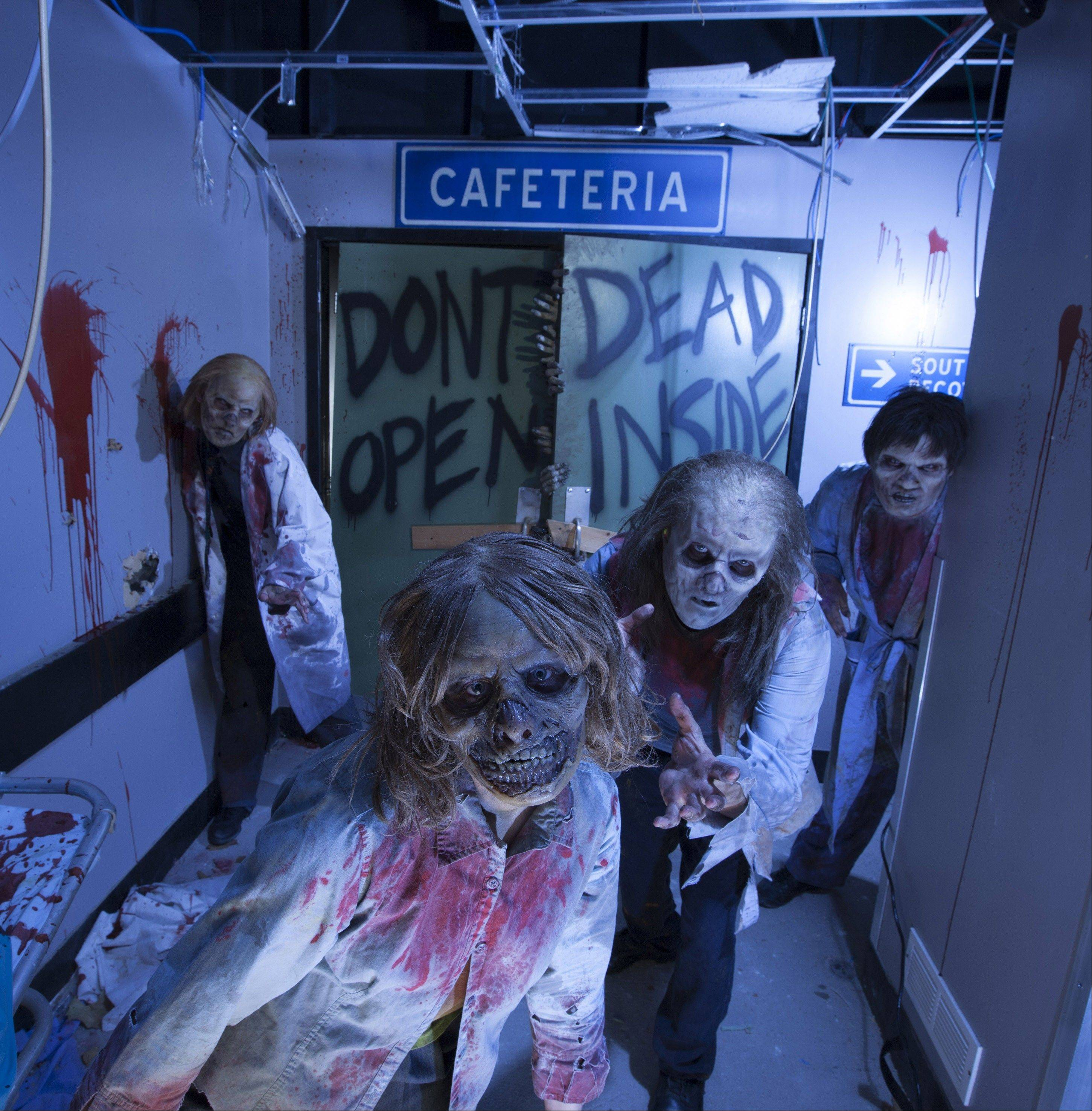 "Actors portray zombies at an attraction based on the AMC show ""The Walking Dead"" at Universal's Halloween Horror Nights in Orlando, Fla."