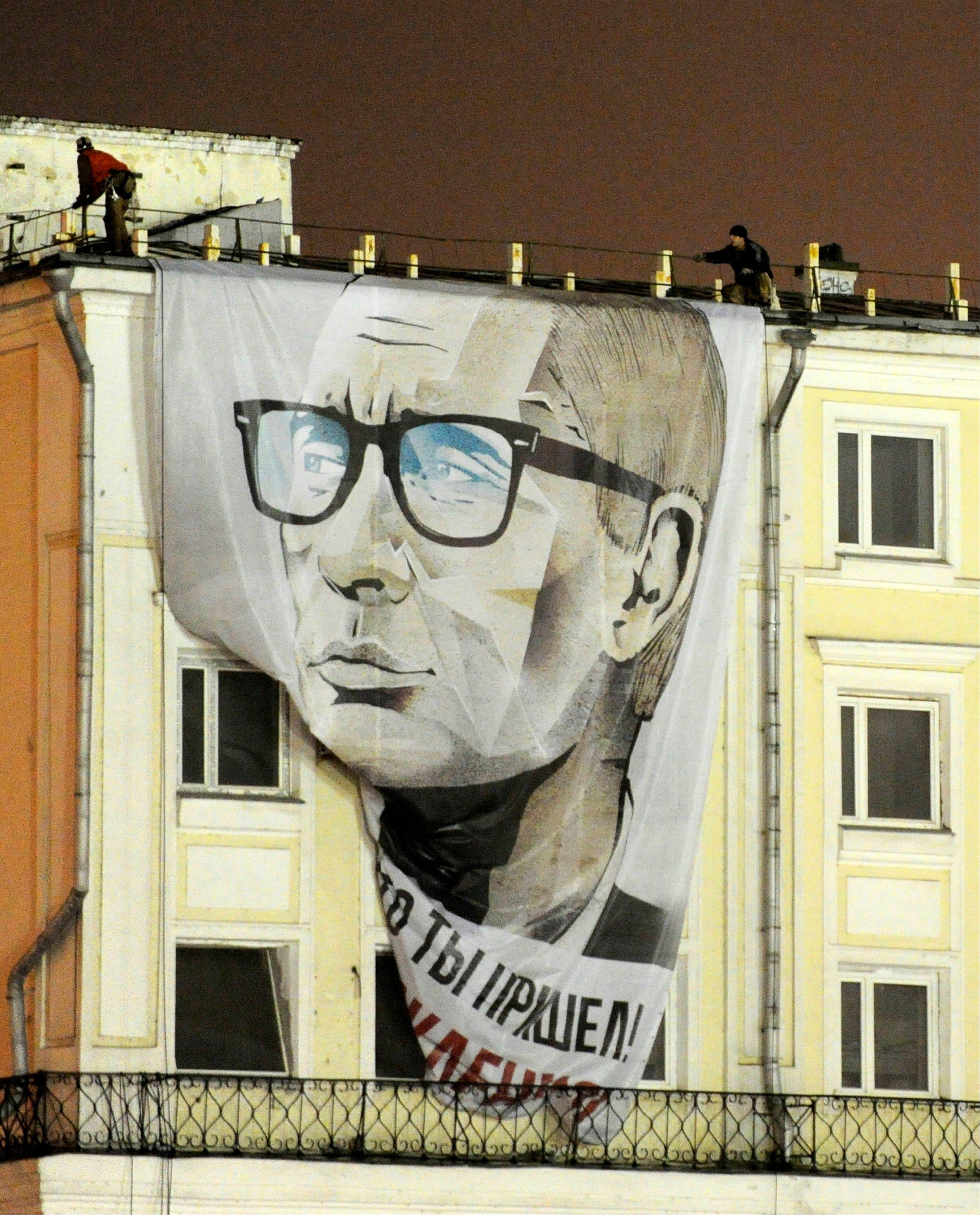 A giant Russian President Vladimir Putin billboard reading �Good that you came. Happy Birthday� hangs on a building in downtown Moscow early Sunday.