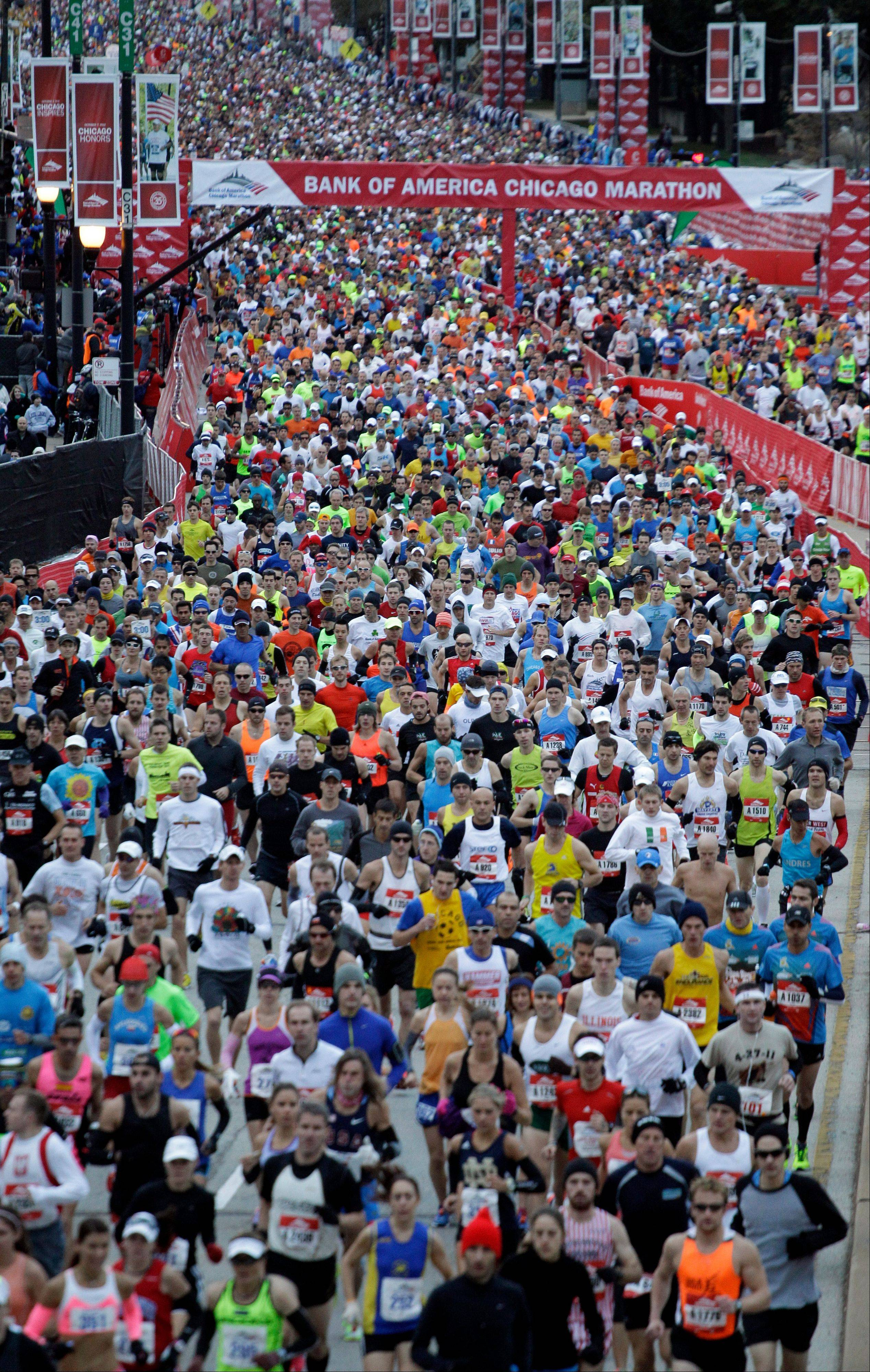 Runners start Sunday�s Chicago Marathon. One runner suffered cardiac arrest around the 21st mile.