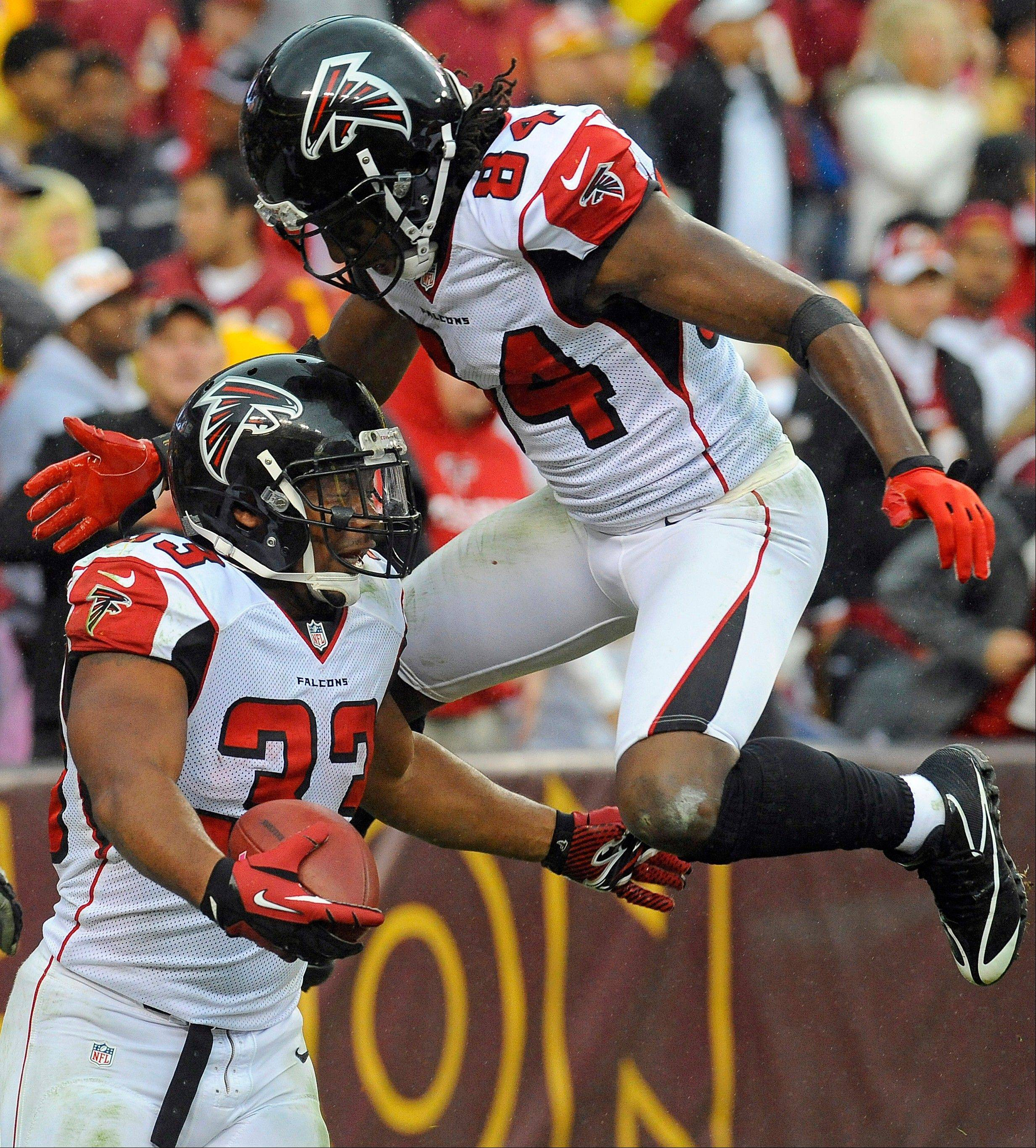 Atlanta Falcons running back Michael Turner (33) celebrates his touchdown with wide receiver Roddy White during the second half Sunday against the Washington Redskins in Landover, Md.