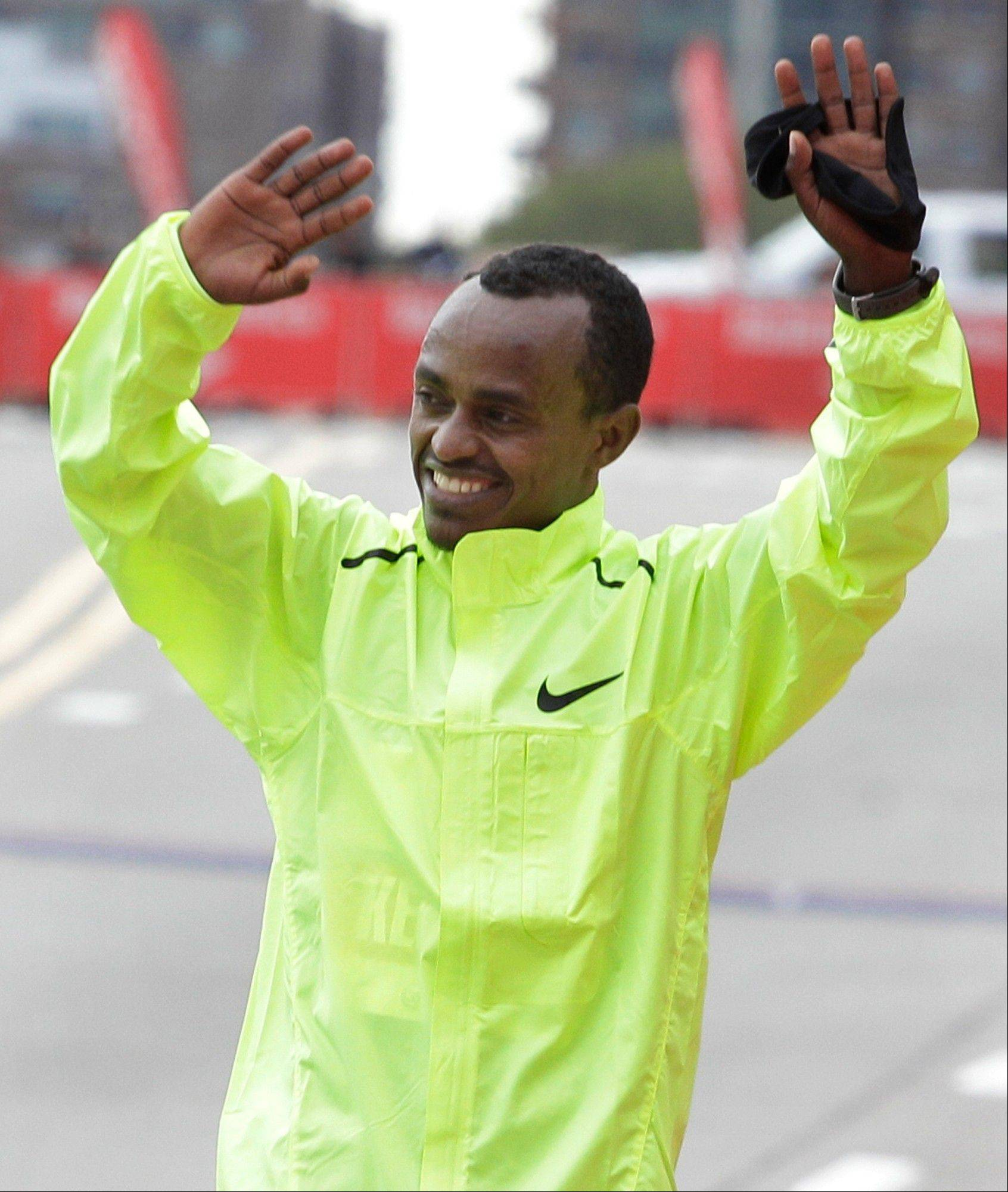 Tsegaye Kebede of Ethiopia celebrates winning the Chicago Marathon on Sunday.