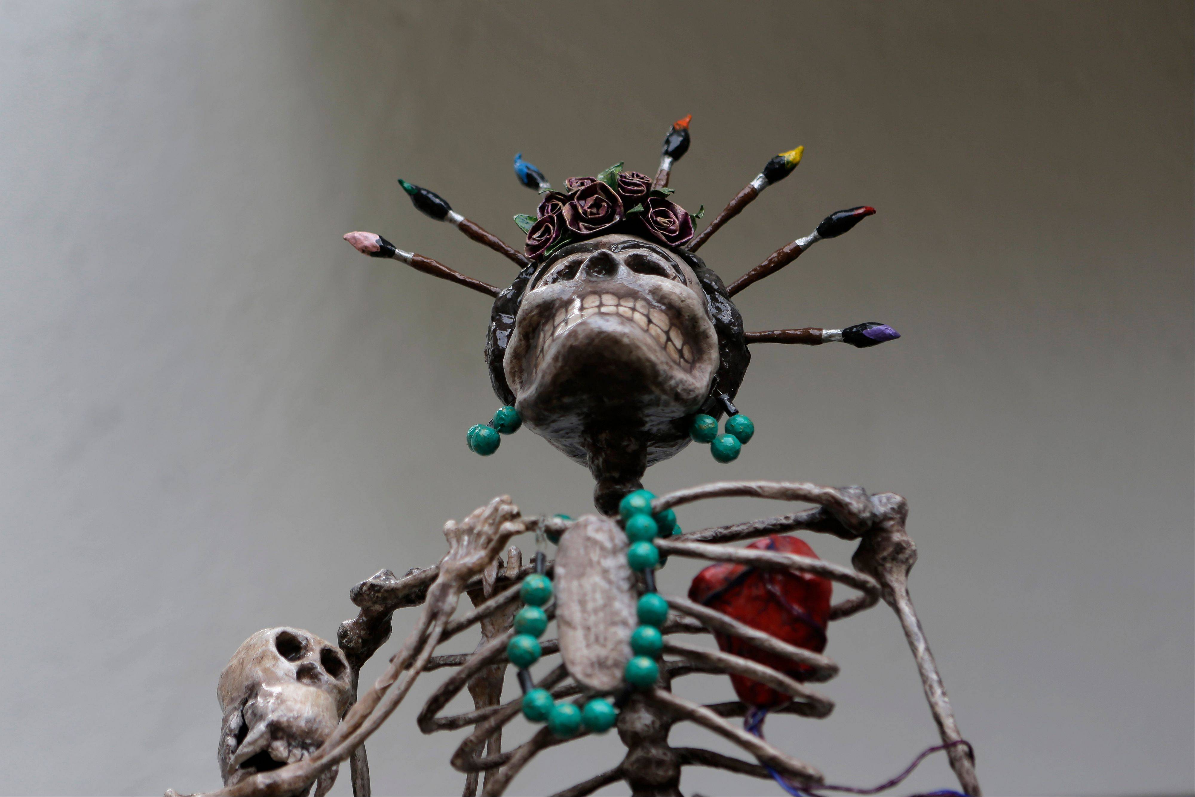 A skeleton sculpture depicting late Mexican artist Frida Kahlo stands on display at the Frida Kahlo museum in Mexico City, Tuesday, Oct. 2, 2012. A full collection from Kahlo's wardrobe will go on public display Nov. 22 in Mexico City after being locked for nearly 50 years in her armoires and dressers: jewelry, shoes and clothes that still carry the scent of the late artist's perfume and cigarette smoke or stains from painting.
