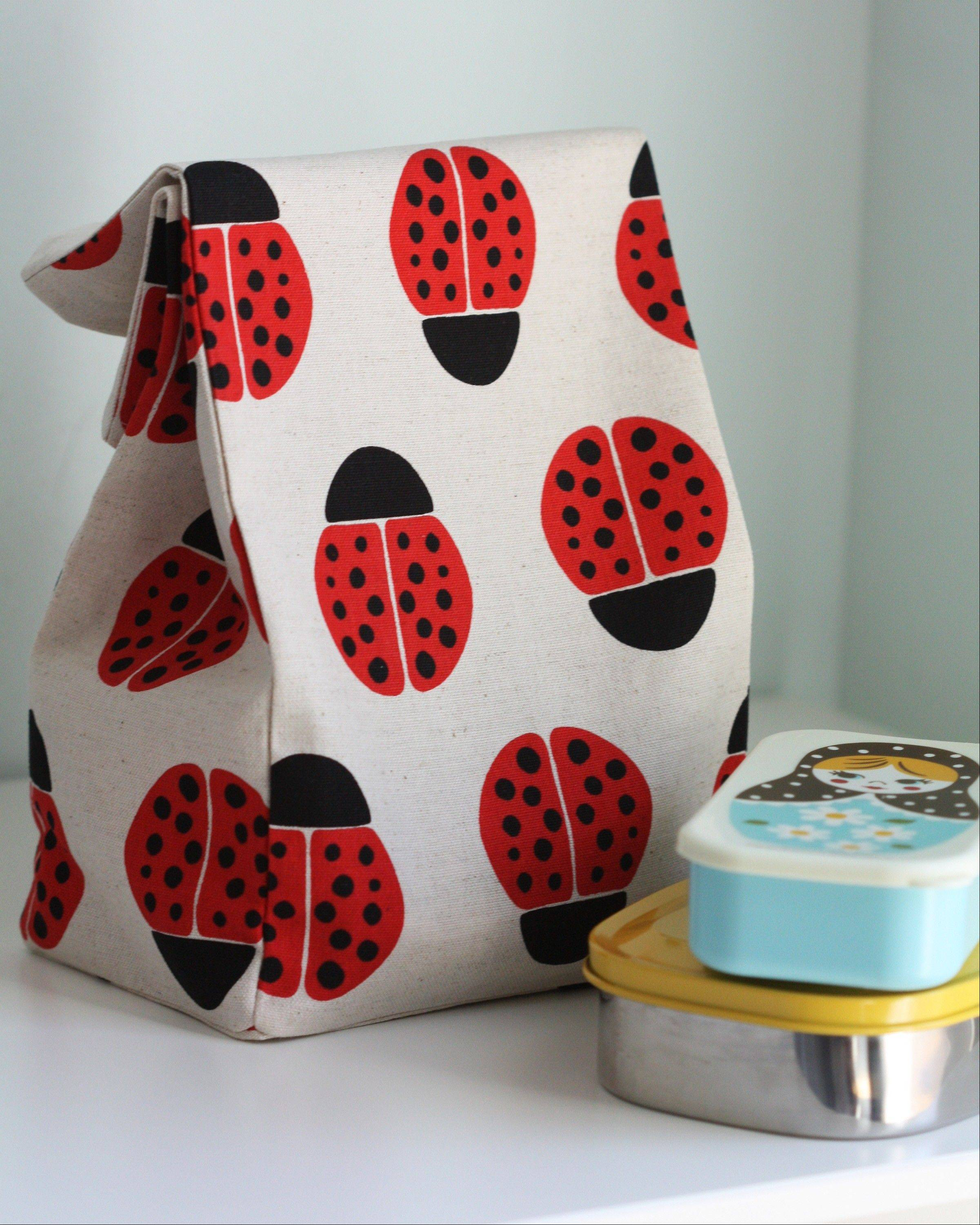 "A bag sewn by Ellen Baker in a Ladybug print fabric she designed for the Japanese company, Kokka, is now in quilt shops in January 2013. Baker used a brown paper bag as a template for this design. She is the author of the book, ""1, 2, 3 Sew: Build Your Skills with 33 Simple Sewing Projects."""