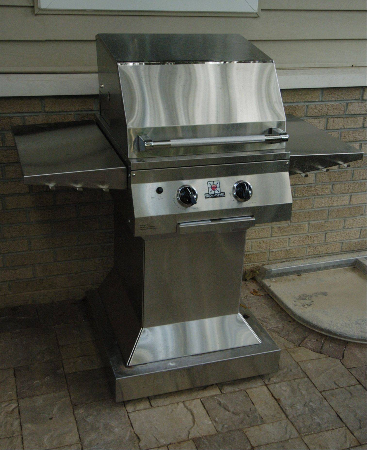 A Solaire grill stands on the Zeecks' patio.
