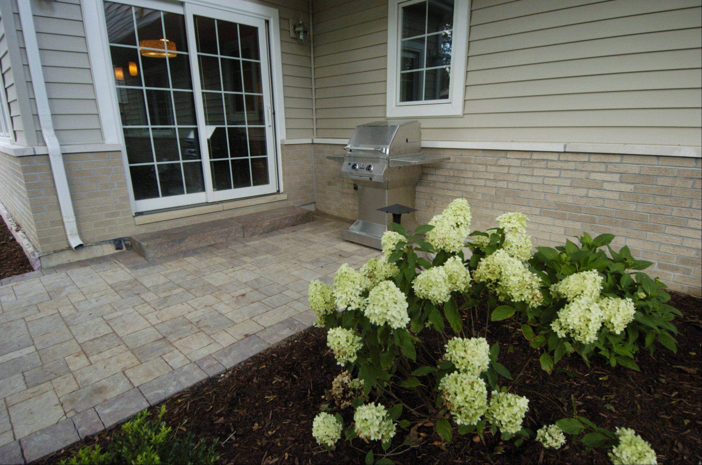 Hydrangeas highlight the landscaping in the Zeecks' backyard.