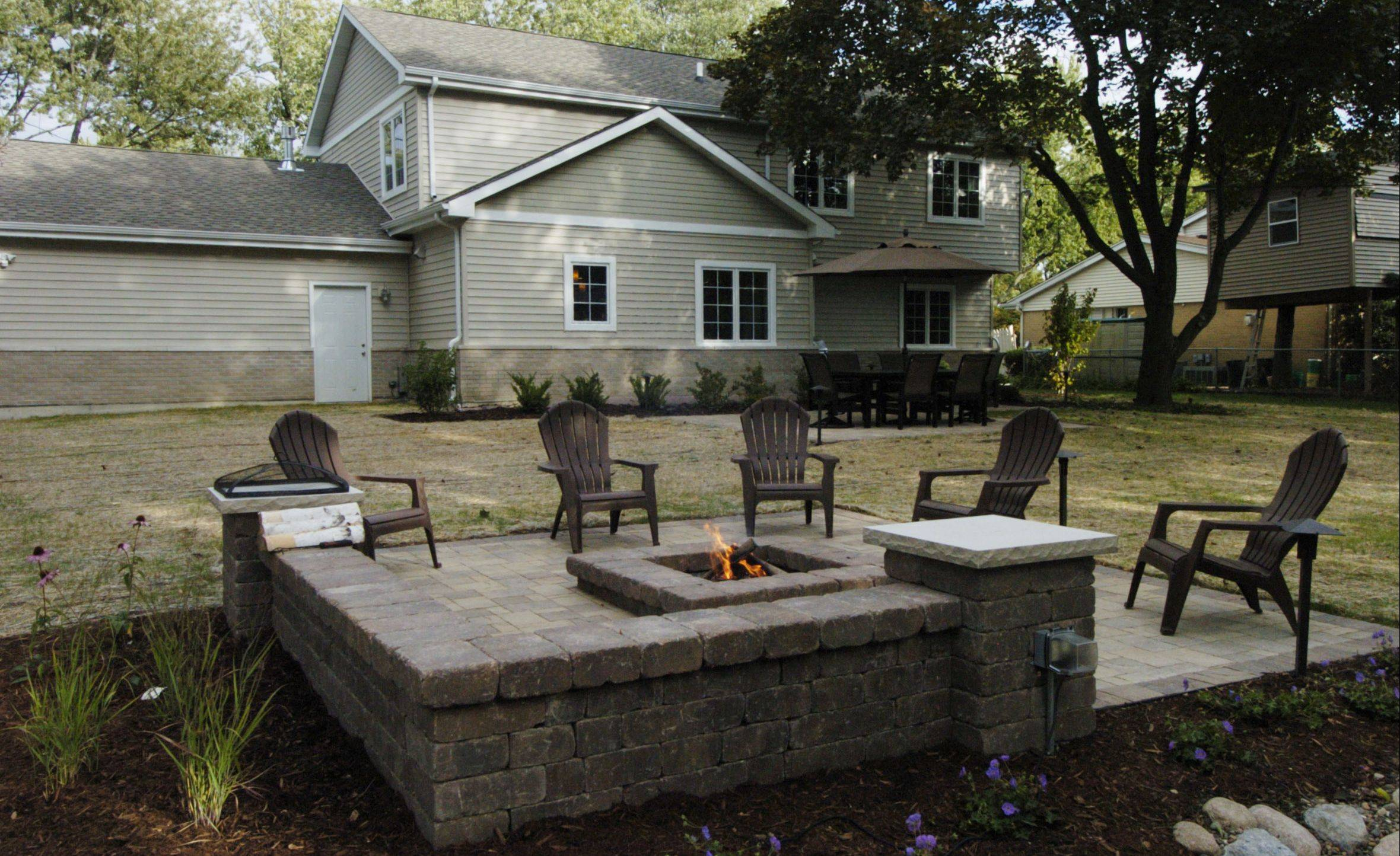 Belgard pavers make up the firepit and seat wall in the Zeecks' Prospect Heights backyard.