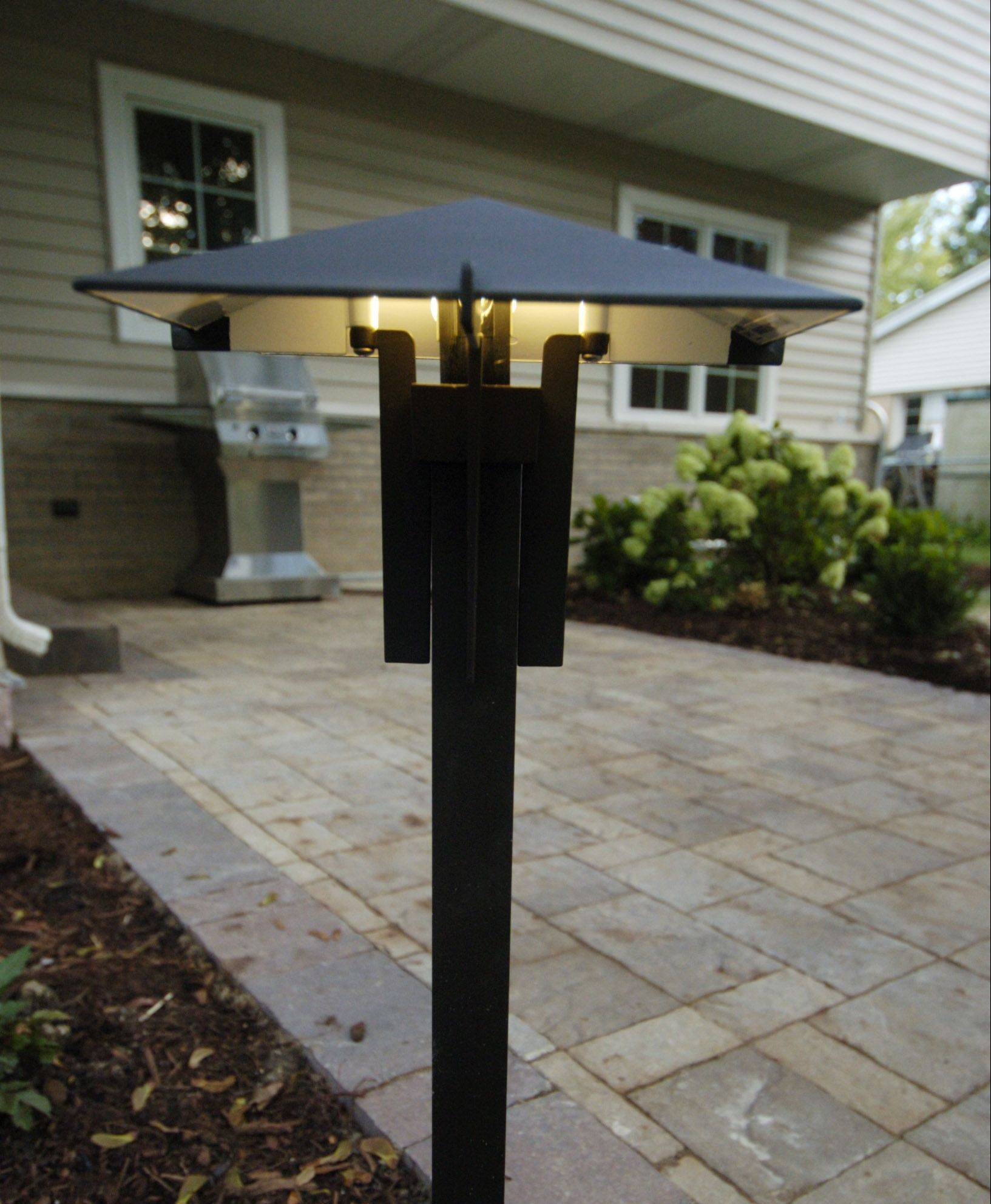 Northwest Electric provided lighting for the backyard, and Upgrade Electric and Lurvey contributed infrastructure for features like the patio of Belgard pavers.
