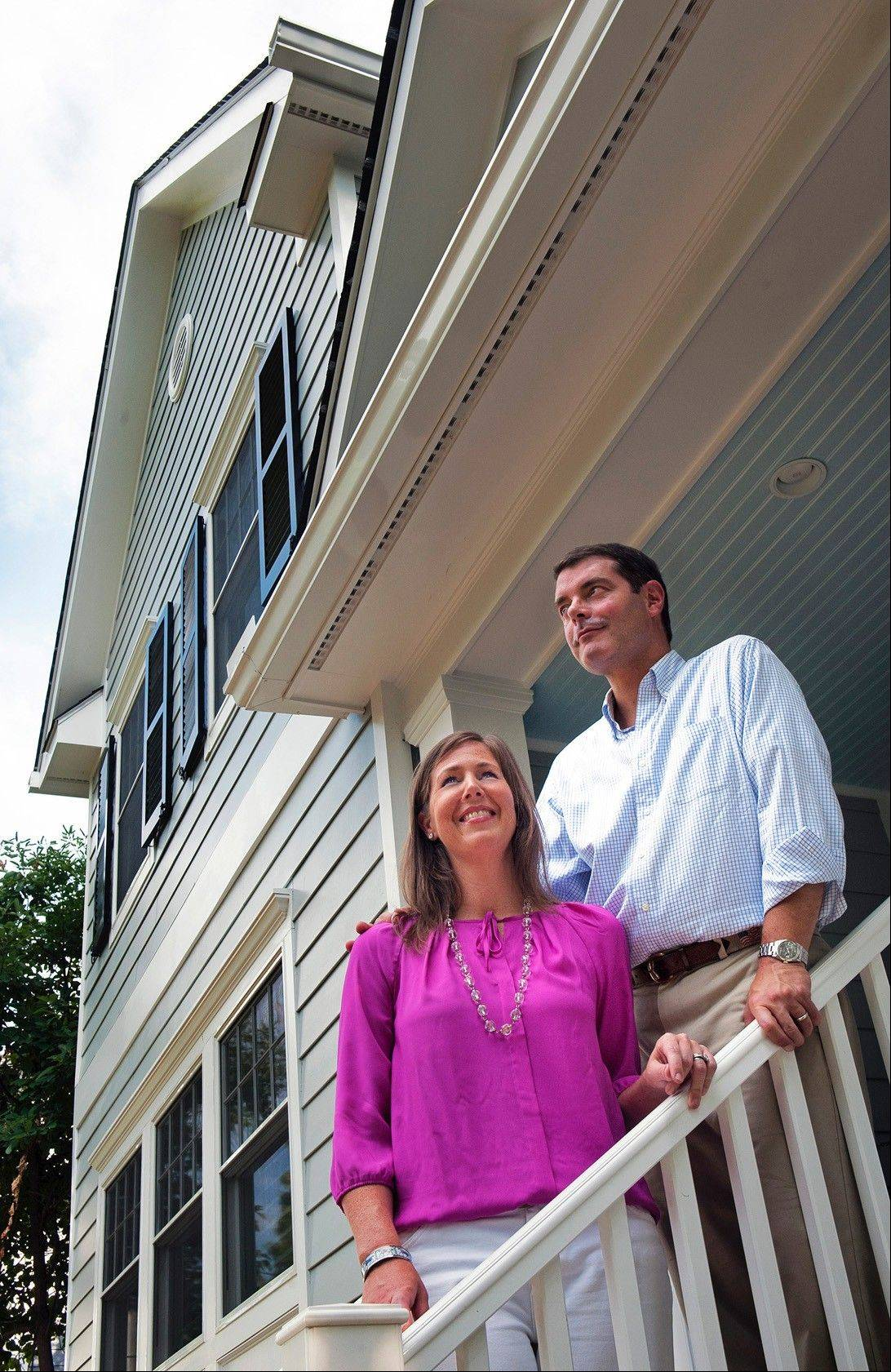 Homeowners Catherine and Nick Swezey, of Washington, D.C., on the front porch of their recently remodeled home.