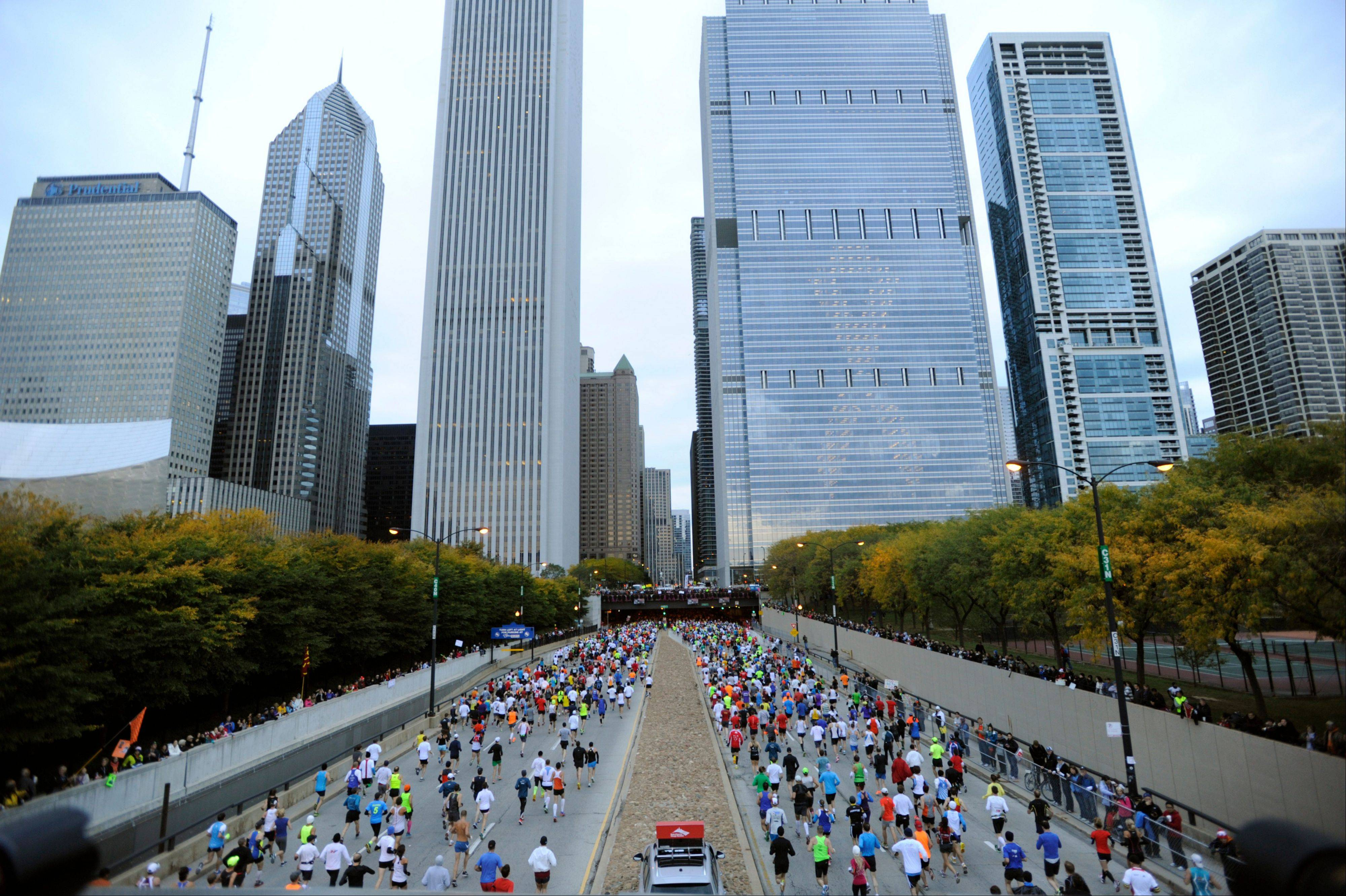 Runners start the 2012 Chicago Marathon Sunday, Oct. 7, 2012. With 42-degree temperatures at the start, the conditions were good for a race marked by tragedy and mishap in recent years.