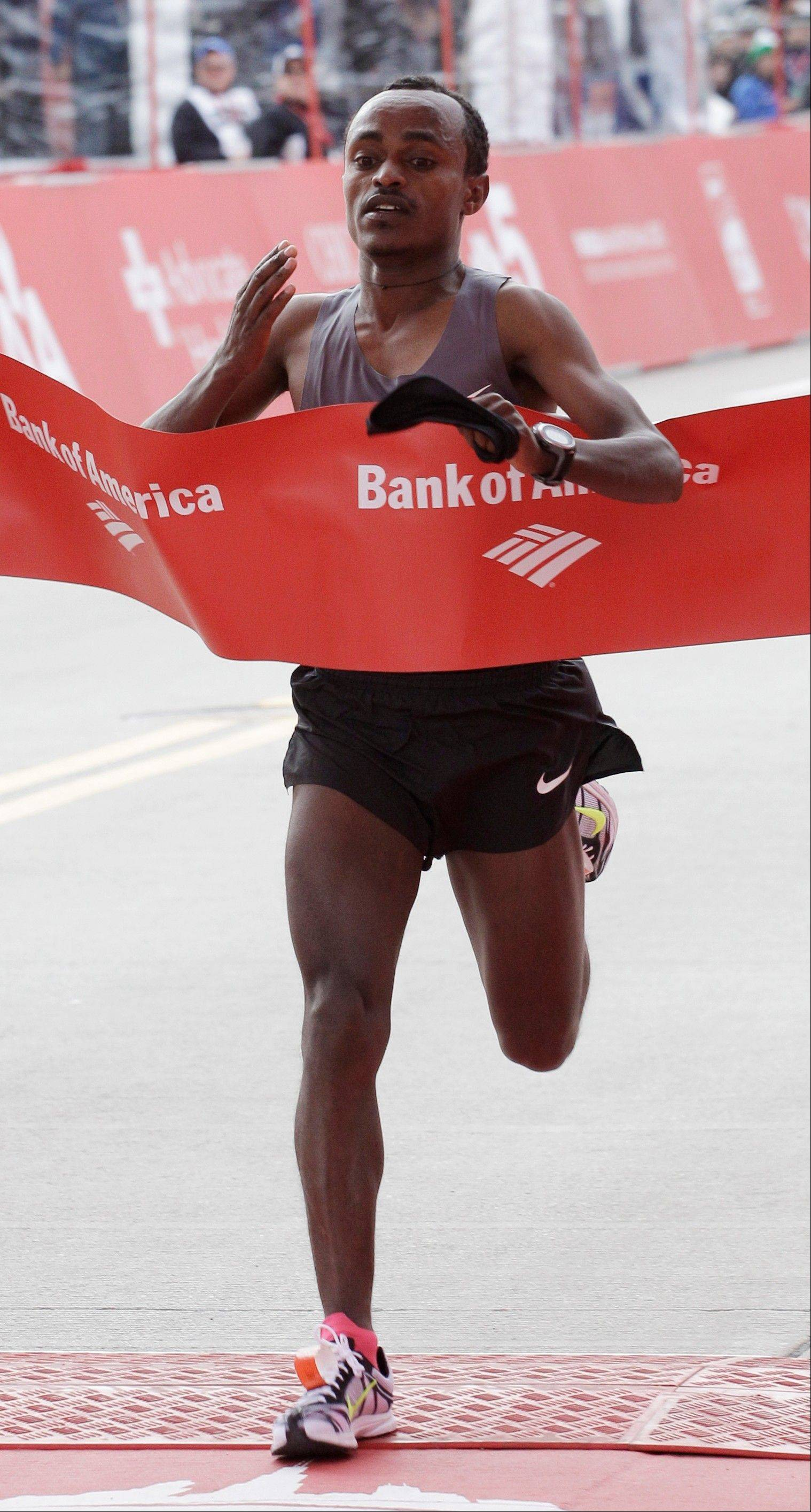 Tsegaye Kebede of Ethiopia, crosses the finish line to win the 2012 Chicago Marathon Sunday, Oct. 7, 2012.